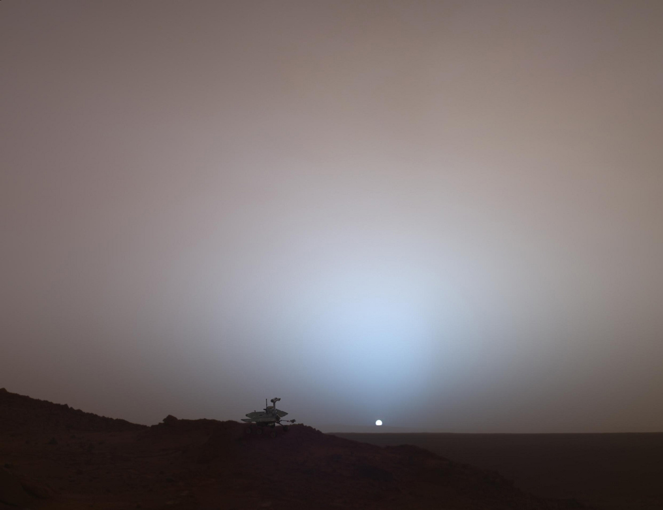 This synthetic image of NASA's Spirit Mars Exploration Rover on top of a rock called 'Jibsheet' was produced using 'Virtual Presence in Space' technology.