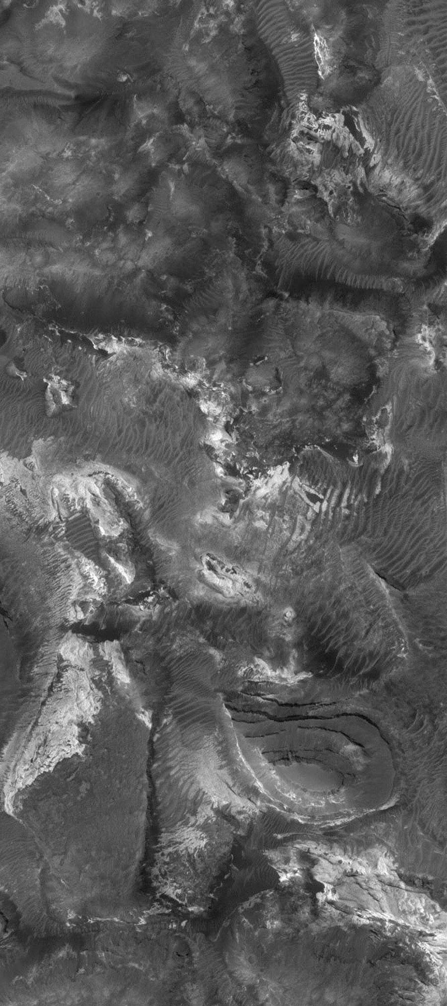 NASA's Mars Global Surveyor shows light-toned rock outcrops, mesas, and buttes in Aram Chaos on Mars. Located immediately west of Ares Vallis, Aram Chaos is a large, nearly-filled impact basin.