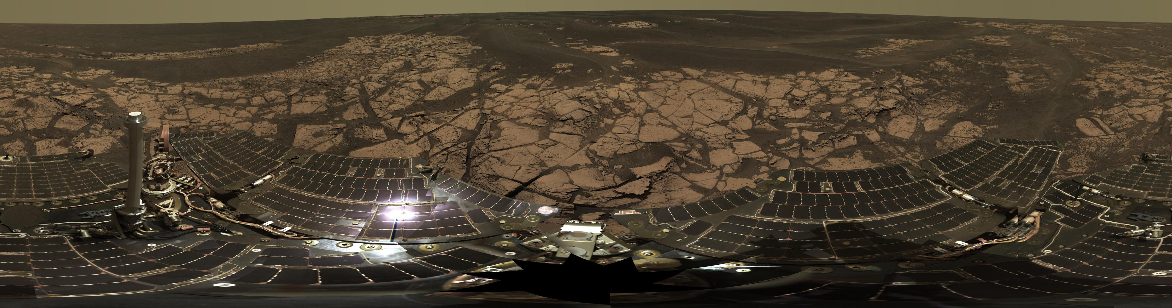 This is the Opportunity panoramic camera's 'Erebus Rim' panorama, acquired on sols 652 to 663 (Nov. 23 to Dec. 5, 2005 ), as NASA's Mars Exploration Rover Opportunity was exploring sand dunes and outcrop rocks in Meridiani Planum.