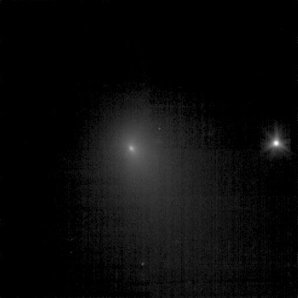 This image of  comet Tempel 1 is a compilation of nine images that were taken on June 19, 2005 by NASA's Deep Impact spacecraft. A star to the right is six times brighter than the brightest pixel of the comet.