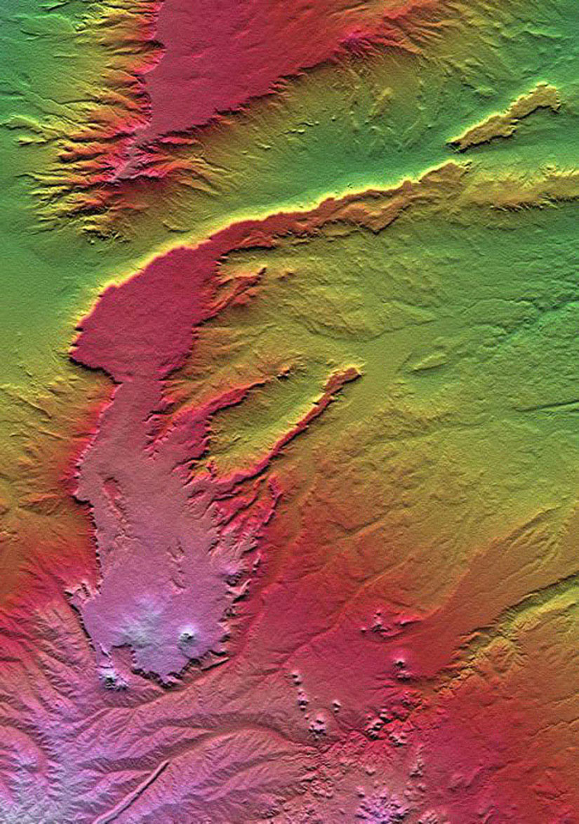 All of the major landforms relate to volcanism and/or erosion in NASA's Shuttle Radar Topography Mission scene of Patagonia, near La Esperanza, Argentina.