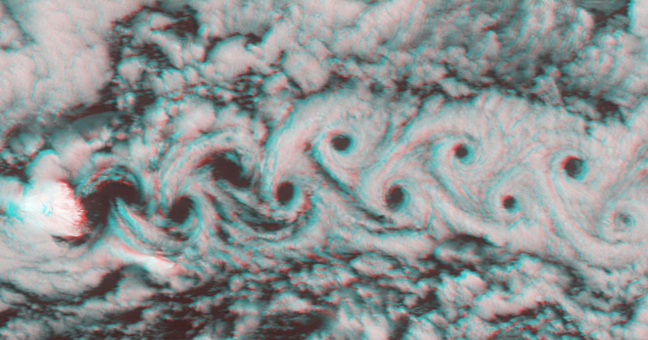 Marine stratocumulus clouds frequently form parallel rows, or 'cloud streets,' along the direction of wind flow. NASA's Terra spacecraft captured this stereo image of Jan Mayen island's Beerenberg volcano. 3D glasses are necessary to view this image.
