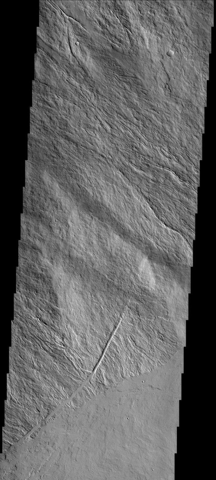 This image shows part of the flank and margin of Ascraeus Mons on Mars as seen by NASA's 2001 Mars Odyssey spacecraft.
