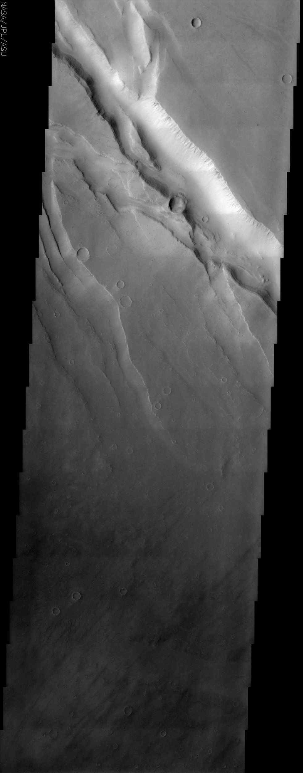 This NASA Mars Odyssey image covers a tract of plateau territory called Ophir Planum. The most obvious features in this scene are the fractures (ranging from 1 to 5 km wide) running from the upper left to lower right.