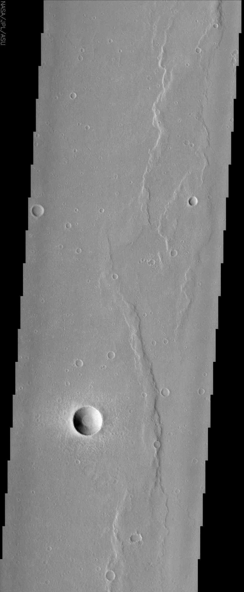 This NASA Mars Odyssey image is of the ridged plains of Lunae Planum in the northern hemisphere of Mars. Wrinkle ridges, a very common landform on Mars, Mercury, Venus, and the Moon, are found mostly along the eastern side of the image.