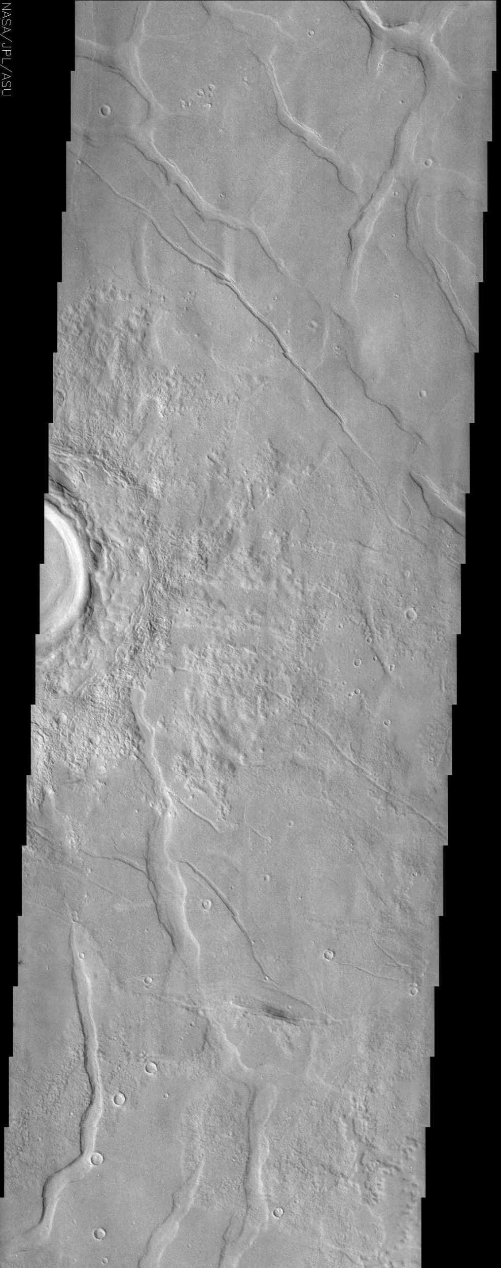 This image by NASA's Mars Odyssey spacecraft shows Utopia Planitia, a large plain in the northern hemisphere of Mars. It is believed that this basin is the result of a large impact.