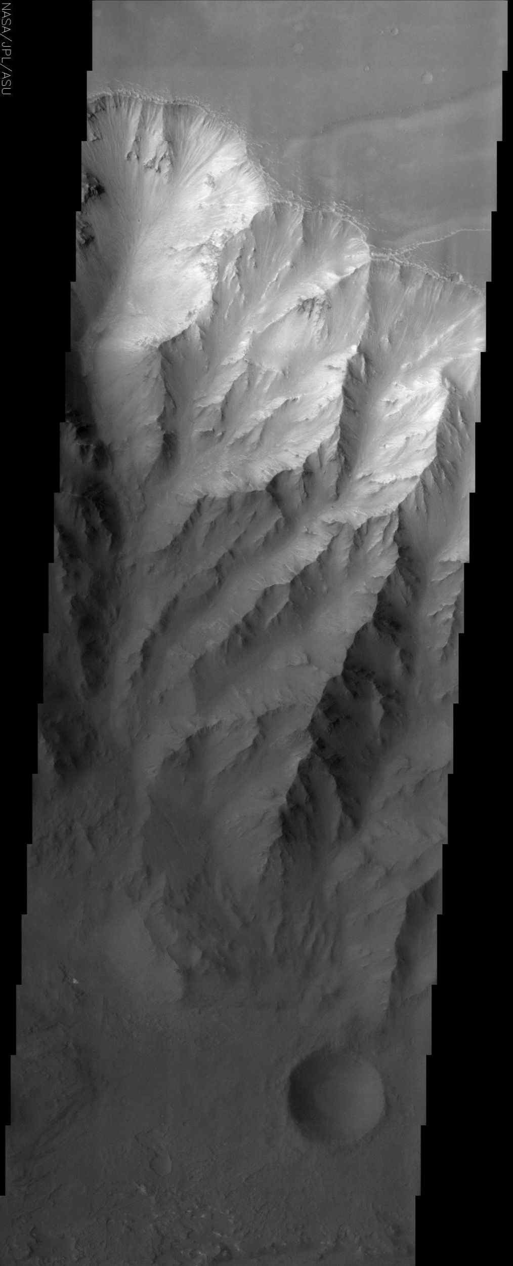 This image from NASA's Mars Odyssey spacecraft shows the northern interior wall of Coprates Chasma, one of the major canyons that form Valles Marineris.