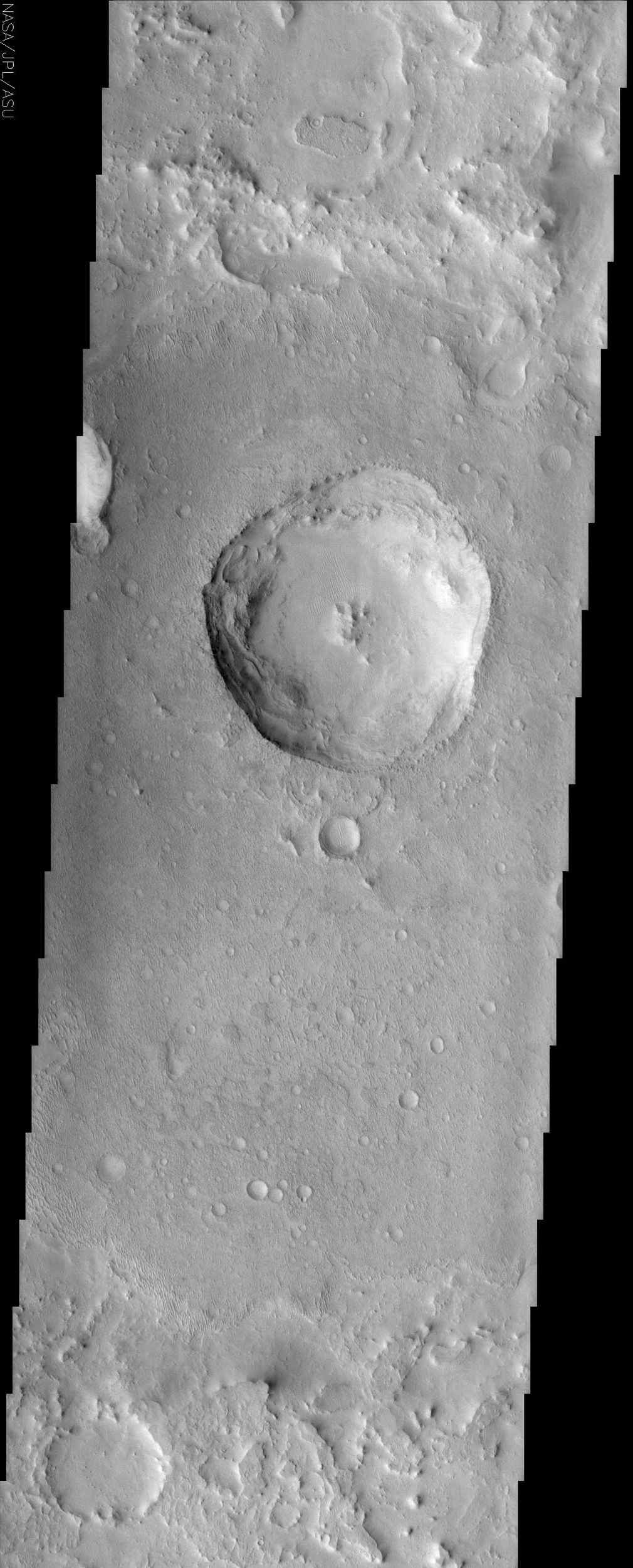 Many places on Mars, such as in this image from NASA's Mars Odyssey spacecraft of a crater superposed on the floor of a larger crater, display scabby, eroded landscapes that commonly are referred to as etched terrain.