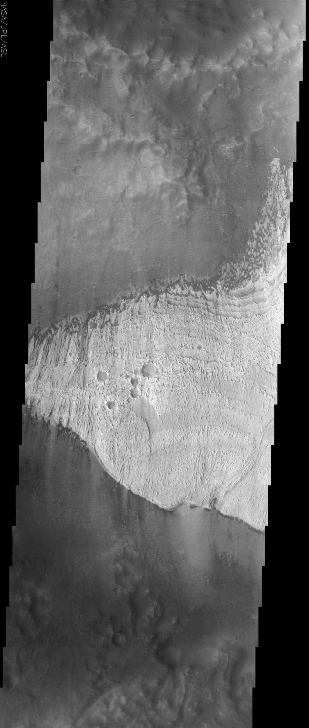 The finely layered deposit in Becquerel crater, seen in the center of this NASA Mars Odyssey image, is slowly being eroded away by the action of windblown sand.
