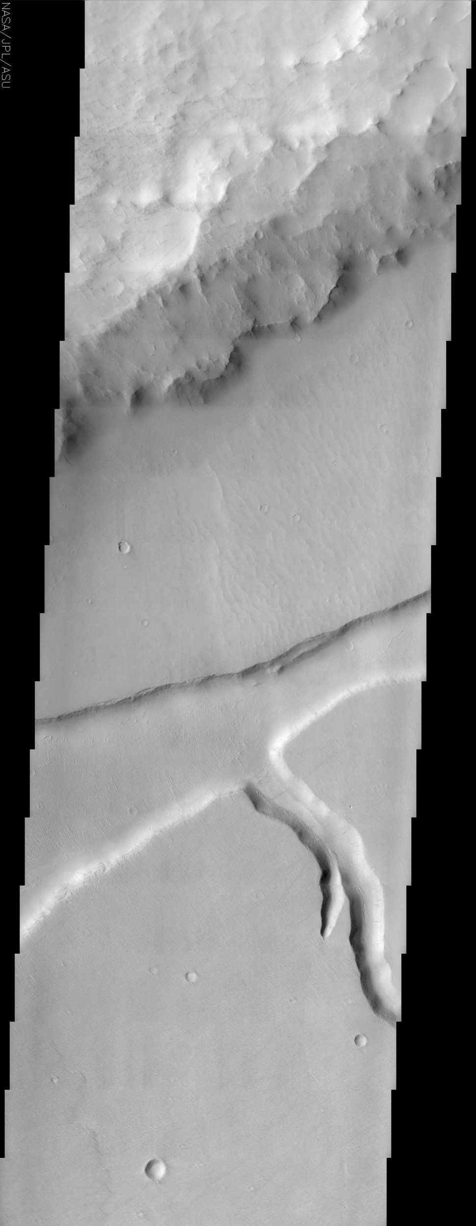 This image from NASA's Mars Odyssey captures Mangala Fossa. Mangala Fossa is a graben, which in geologic terminology translates into a long parallel to semi-parallel fracture or trough.