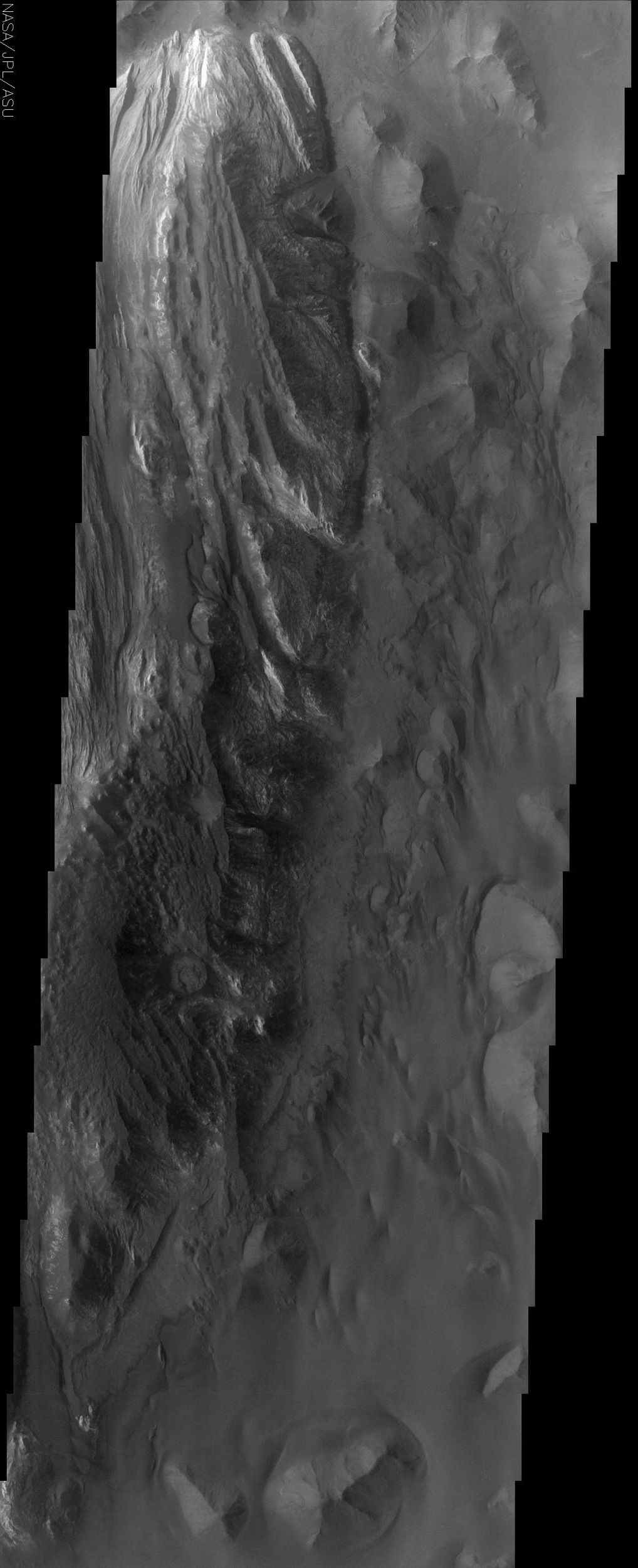 Juventae Chasma is an enormous box canyon which opens to the north and forms the outflow channel Maja Vallis. This image from NASA's Mars Odyssey spacecraft captures a portion of the western floor of Juventae Chasma and shows a wide variety of landforms.