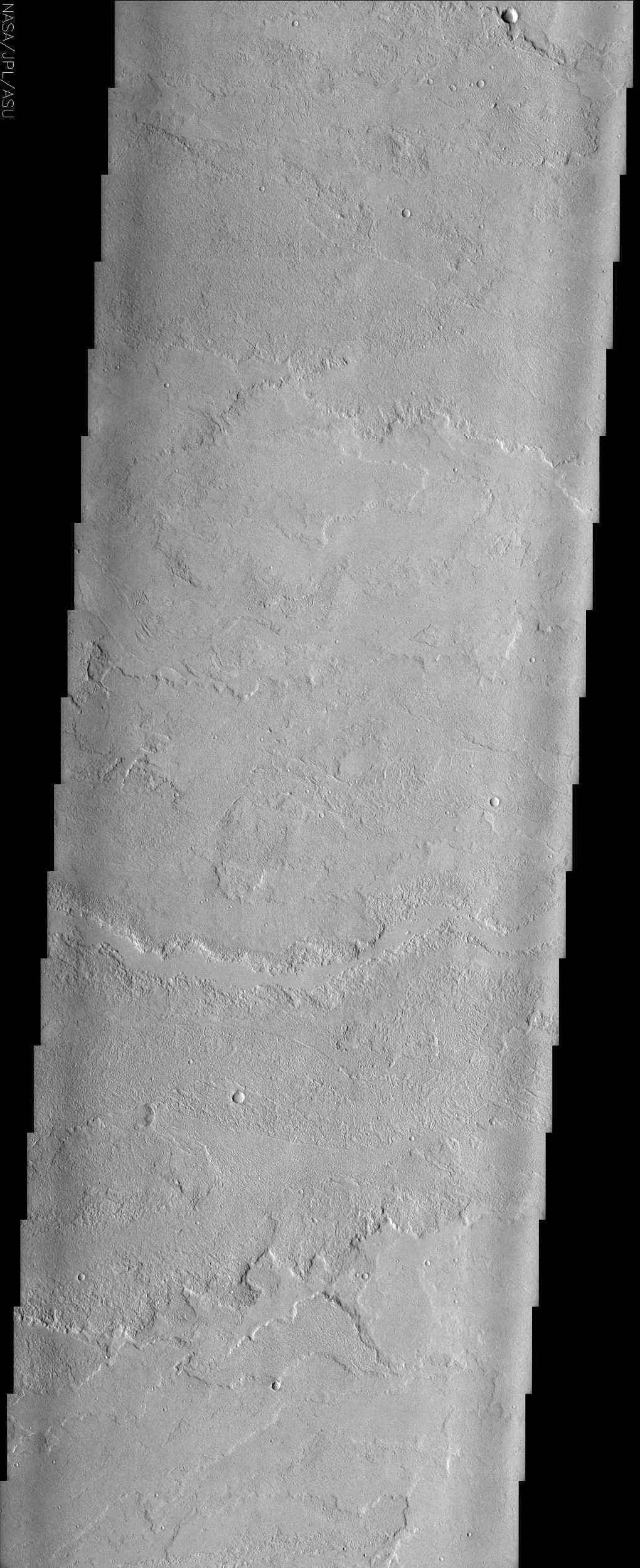 This image to the east of Tharsis Tholus from NASA's Mars Odyssey spacecraft shows one of many vast fields of lava flows produced by the great Tharsis volcanoes.