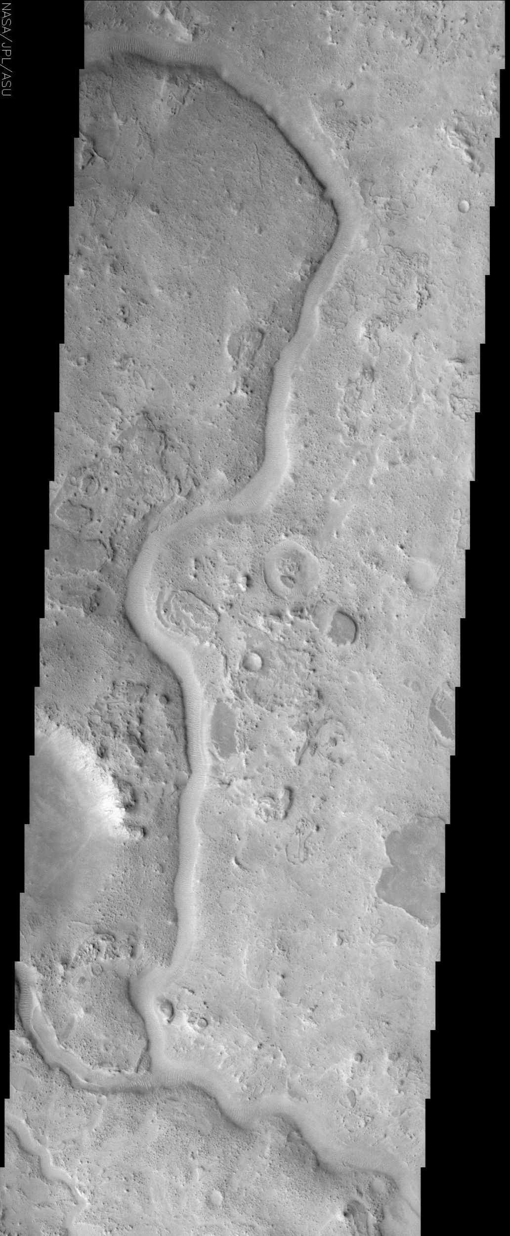 The ancient sinuous river channel shown in this image by NASA's Mars Odyssey spacecraft was likely carved by water early in Mars history. Auqakuh Valles cuts through a remarkable series of rock layers that were deposited and then subsequently eroded.