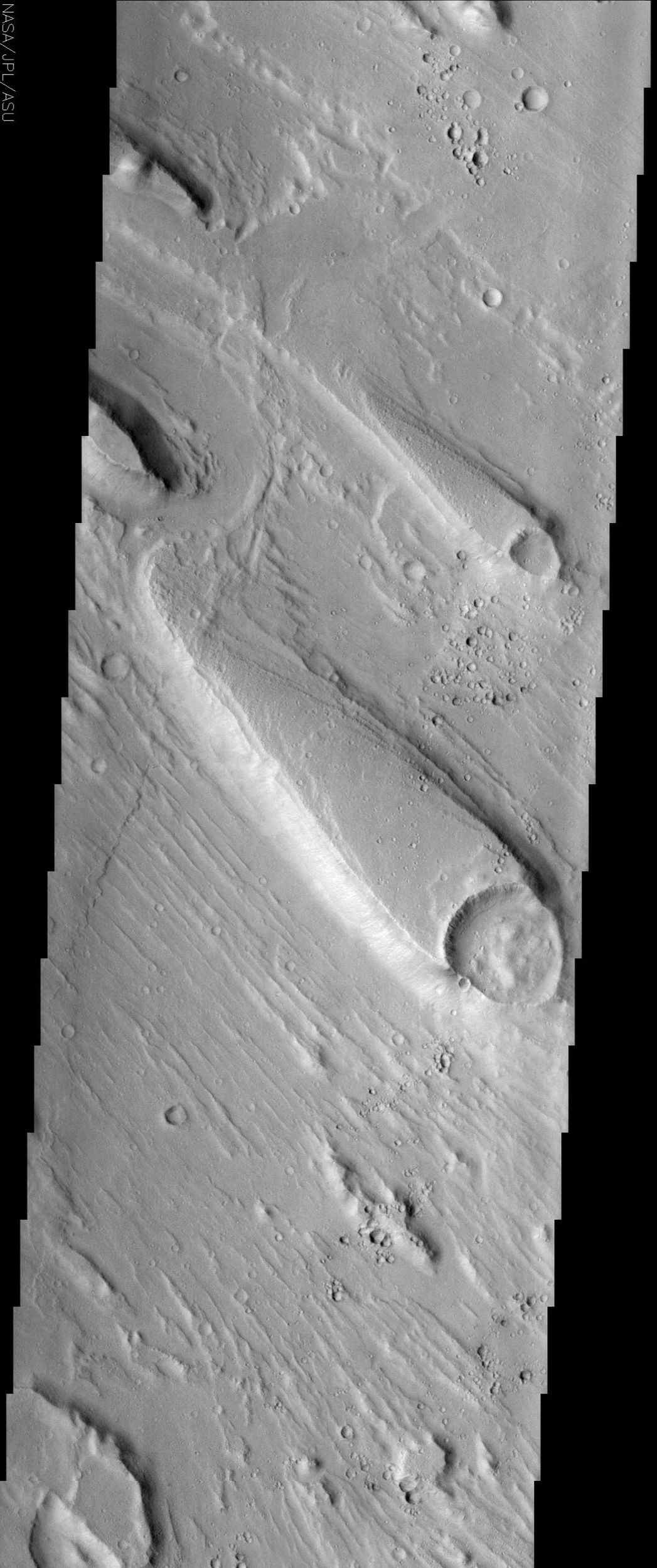 Streamlined islands, like the one shown in this NASA Mars Odyssey image, are one piece of geologic evidence that large quantities of water once flowed across the surface of Mars in the distant past.