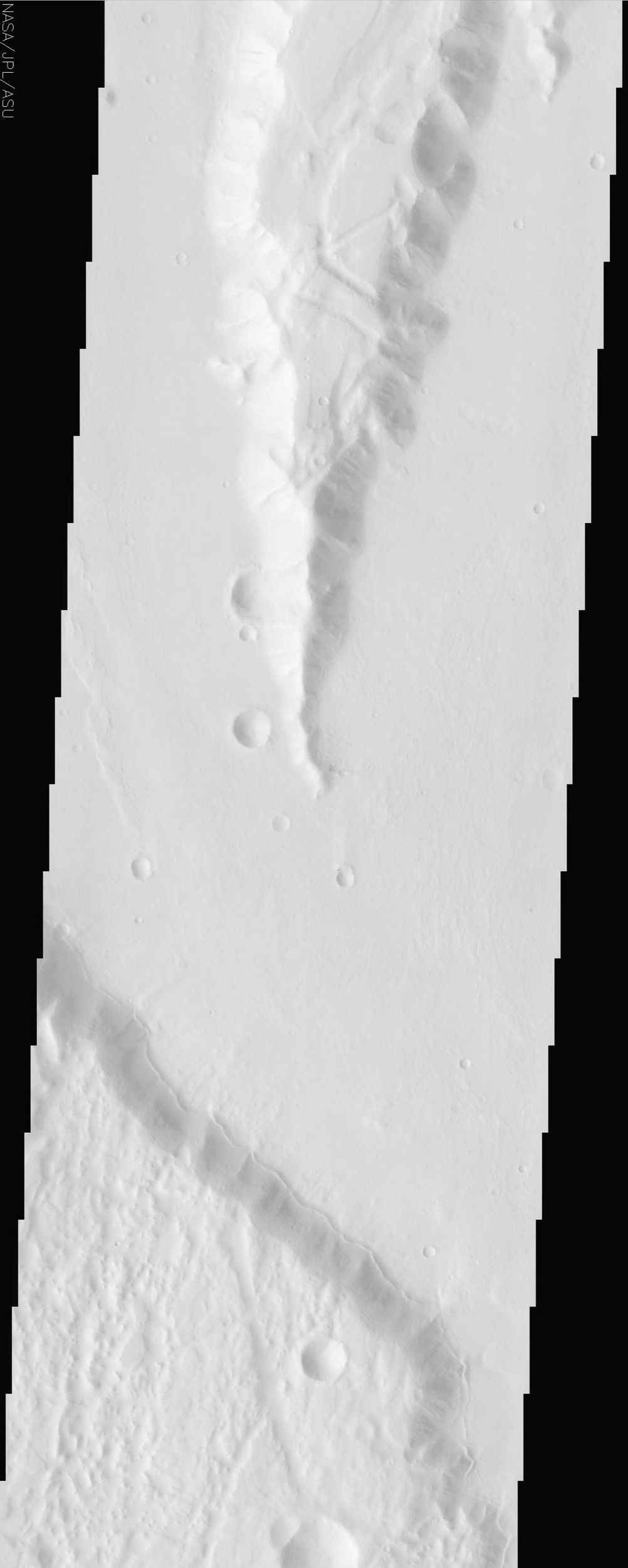 This image by NASA's Mars Odyssey spacecraft is within a region called Lunae Planum, west of NASA's Viking 1 landing site, that marks the transition between the Tharsis rise, a giant volcanic complex, and the northern lowland plains.