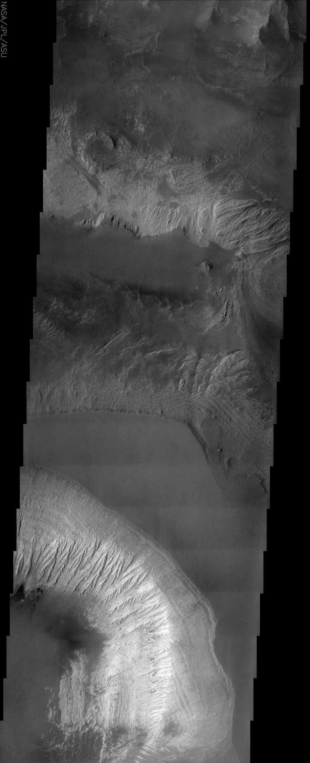 This NASA Mars Odyssey image shows the effects of erosion on a beautiful sequence of dramatically layered rocks within Candor Chasma, which is part of the Valles Marineris.