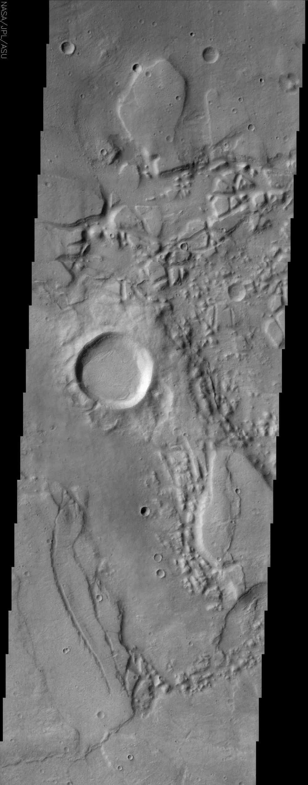 The jumbled, chaotic terrain in this NASA Mars Odyssey image may represent a source region for the Reull Vallis, one of the larger channel systems in the southern hemisphere of Mars.
