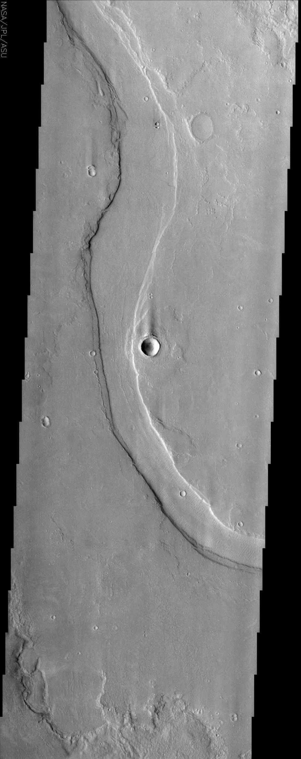 Hrad Valles, seen in this image from NASA's Mars Odyssey spacecraft, is located north-northwest of the large Elysium Mons volcanic complex and is yet another example of a channel that likely carried fluids.