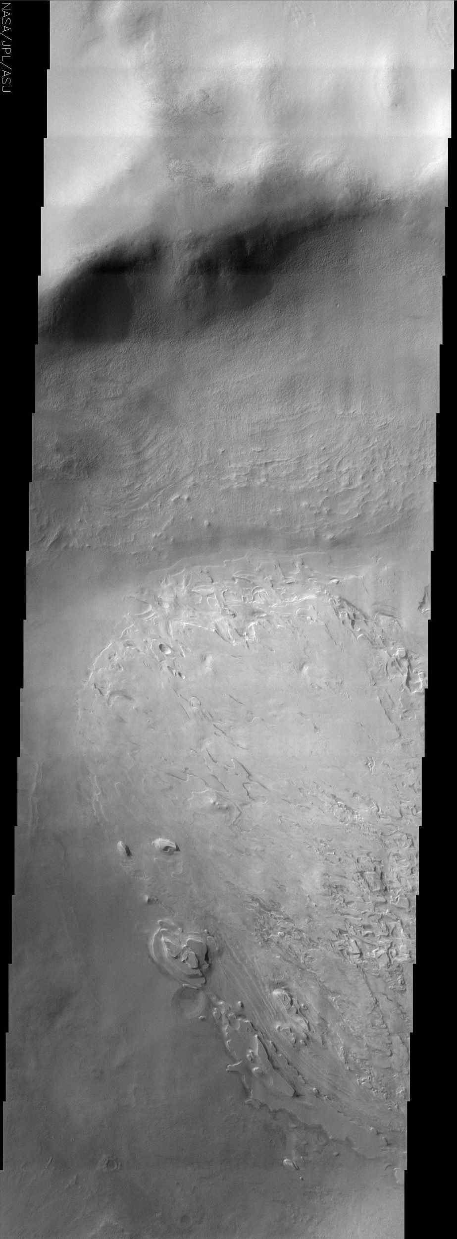 The craters on Mars display a variety of interior deposits, one of which is shown in this image from NASA's Mars Odyssey. Spallanzani Crater is located far enough south that it probably experiences the seasonal growth and retreat of the south polar cap.