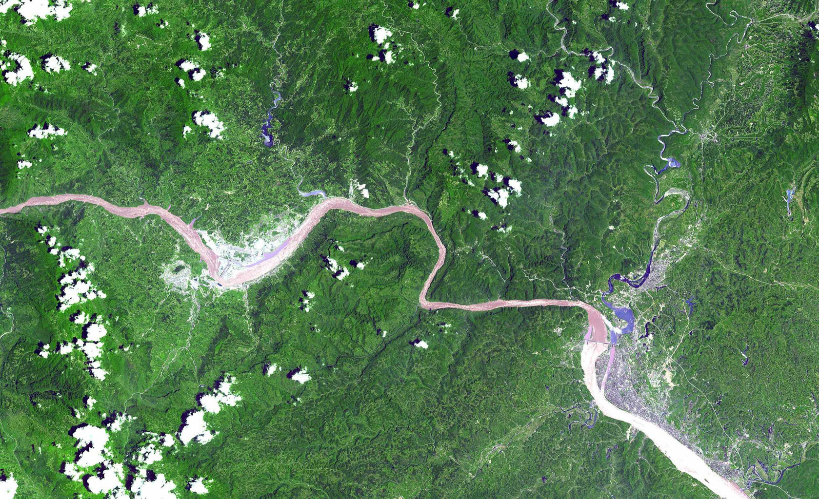 This image from NASA's Terra spacecraft shows a 60 km stretch of the Yangtze River in China, including the Xiling Gorge, the eastern of the three gorges. At left of image is the construction site of theThree Gorges Dam, the world's largest.
