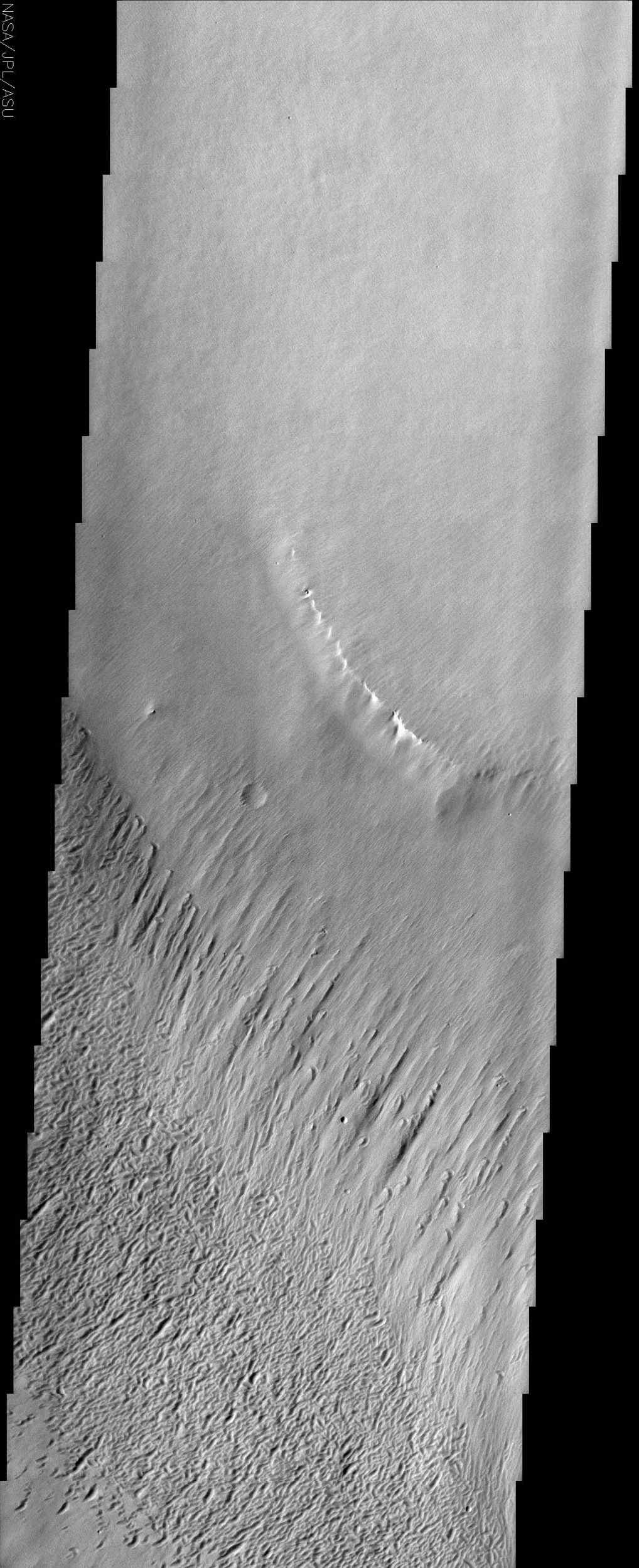 This image from NASA's Mars Odyssey covers a portion of the Medusa Fossae formation, near the equator of Mars. The most characteristic feature of the Medusa Fossae formation is the abundance of 'yardangs,' which are erosional landforms carved by wind.