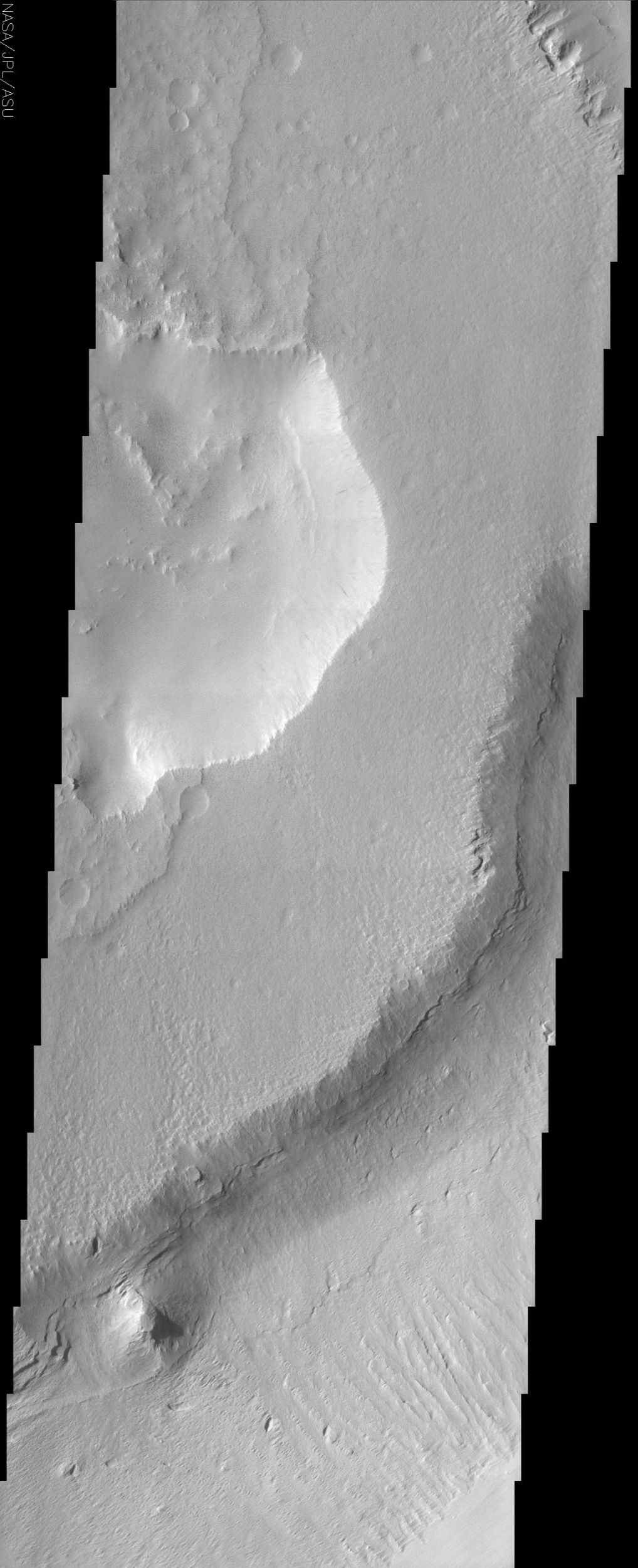 This image from NASA's Mars Odyssey shows a sample of the middle member of the Medusae Fossae formation. The layers exposed in the southeast-facing scarp suggest that there is a fairly competent unit underlying the mesa in the center of the image.