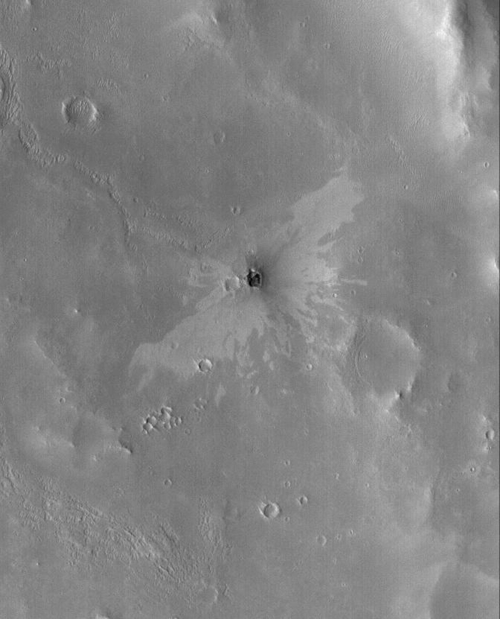 NASA's Mars Global Surveyor shows a small impact crater with a 'butterfly' ejecta pattern. The butterfly pattern results from an oblique impact.