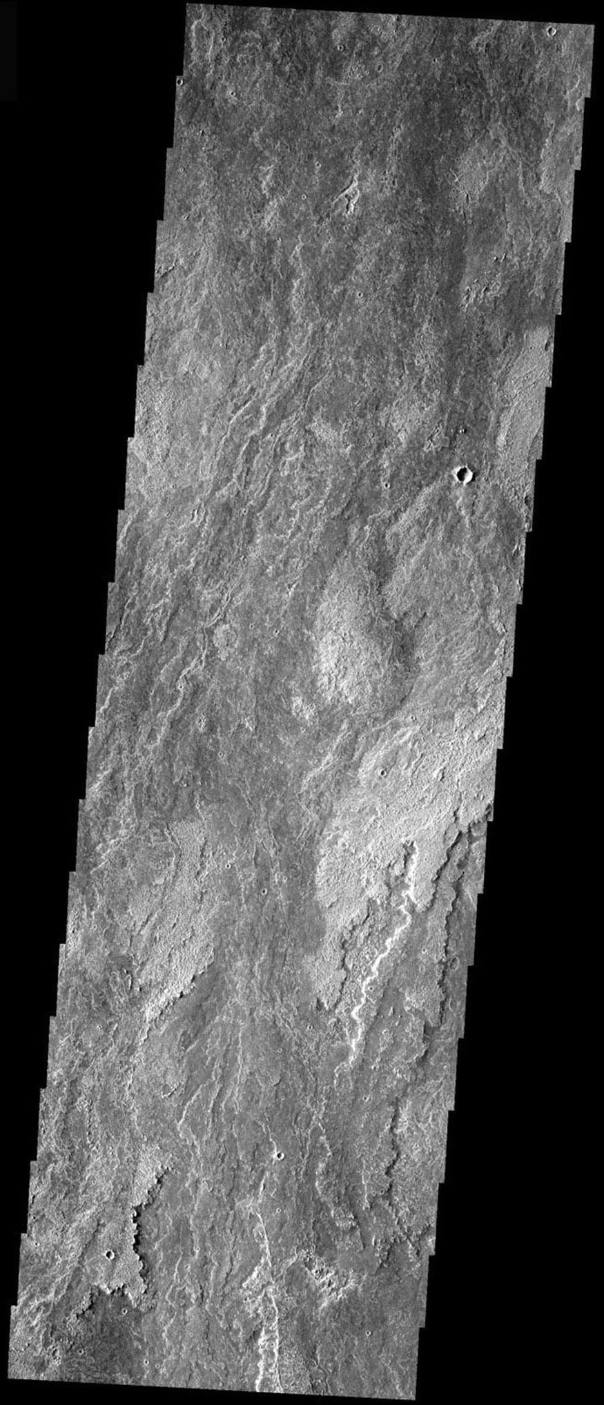 The lava flows from Arsia Mons are some of the youngest flows in the region, as seen in this image from NASA's Mars Odyssey spacecraft. The flows are long, fairly narrow, overlapping, and with various surface features and textures.