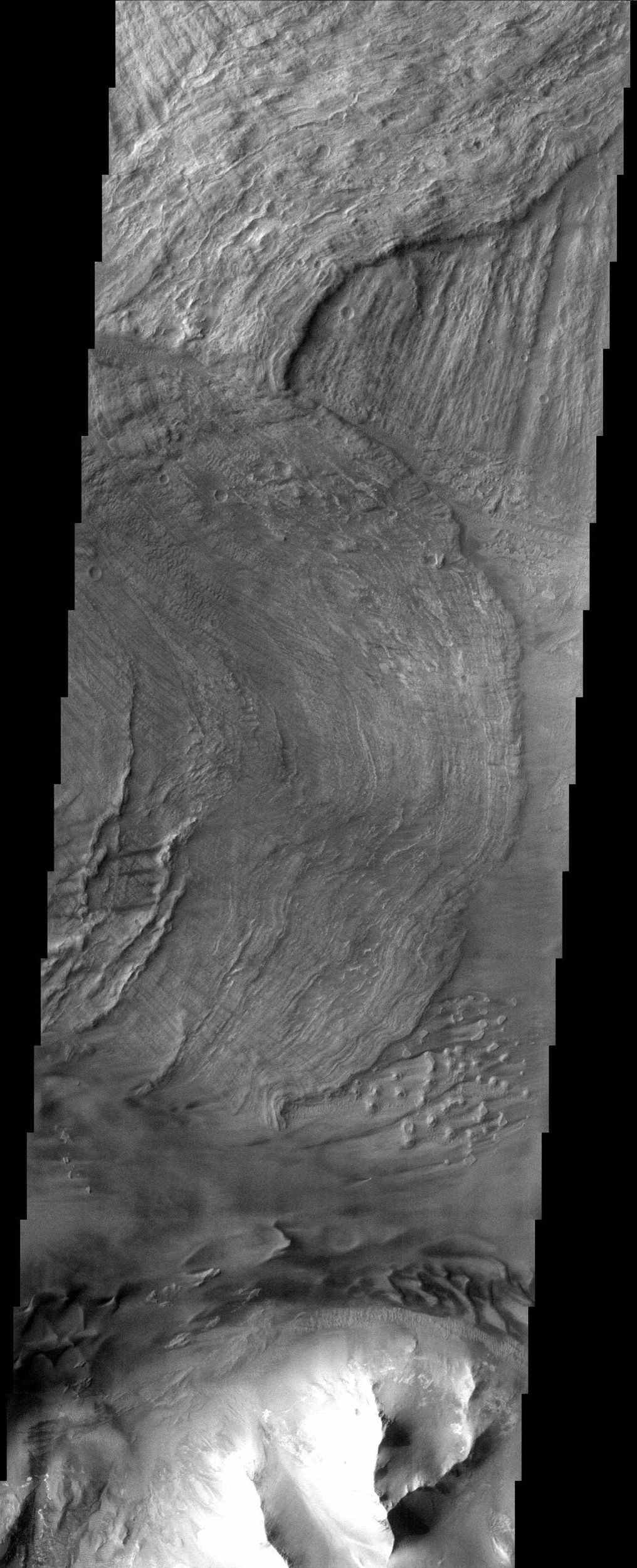 This canyon system imaged here by NASA's Mars Odyssey was named Valles Marineris in honor of its discoverer, NASA's Mariner 9 spacecraft. The image covers a portion of the canyon system called Melas Chasma.