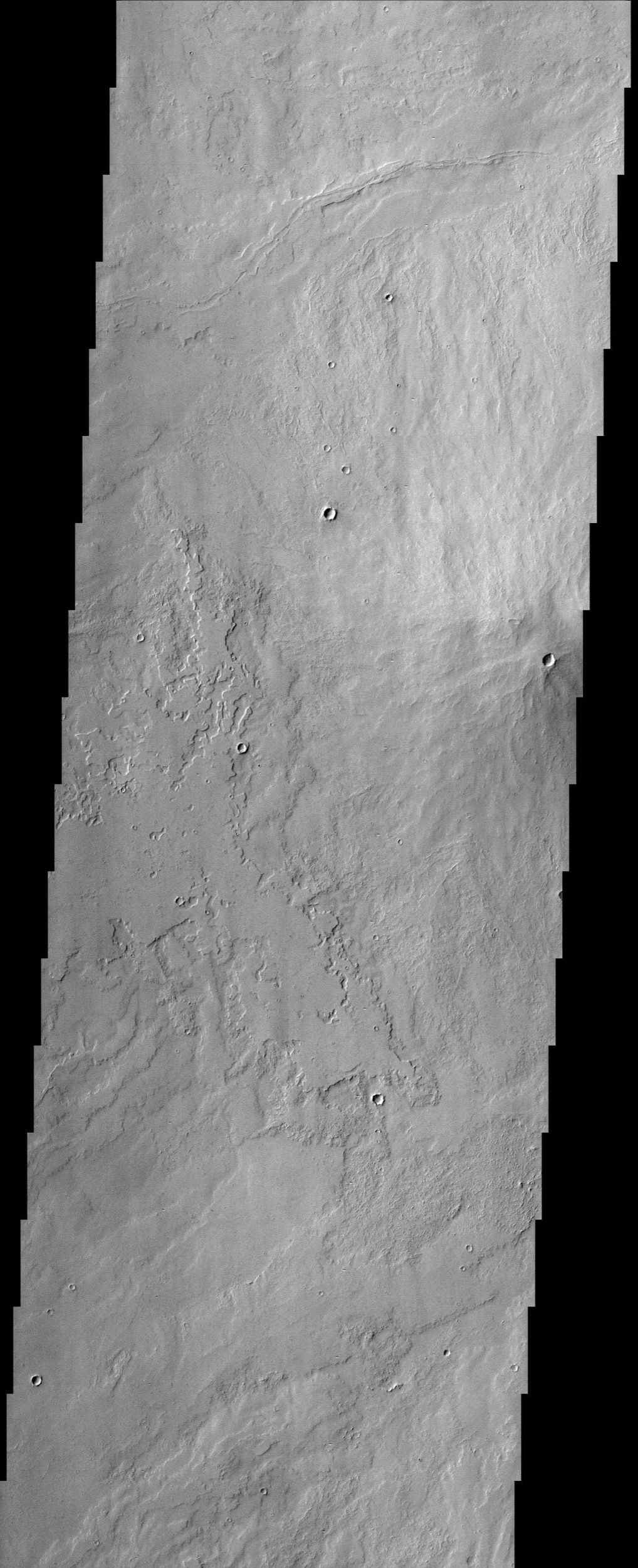 The small crater observed at the middle-right edge of this NASA Mars Odyssey image is very different from other similar looking impact craters located southeast of the Pavonis Mons volcano.