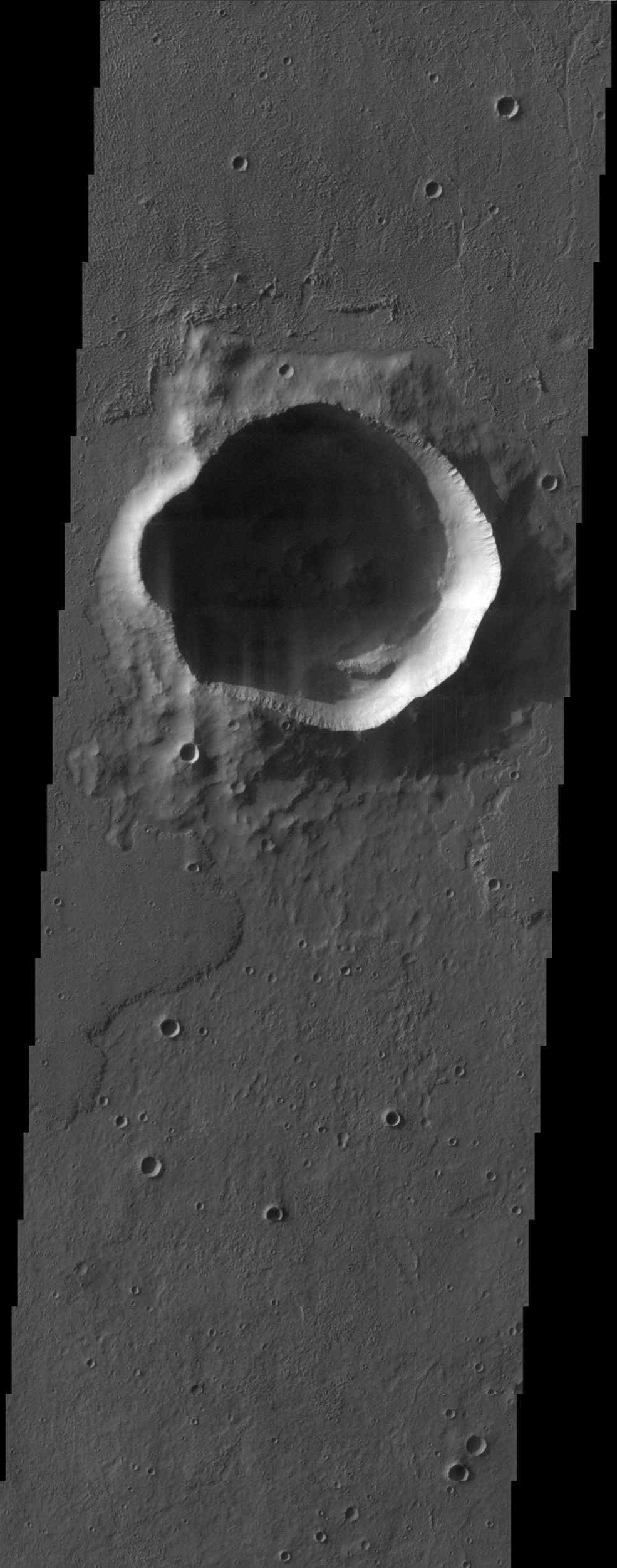 The irregularly shaped rim of the bowl-shaped impact crater in this NASA Mars Odyssey image is most likely due to erosion and the subsequent infilling of sediment.