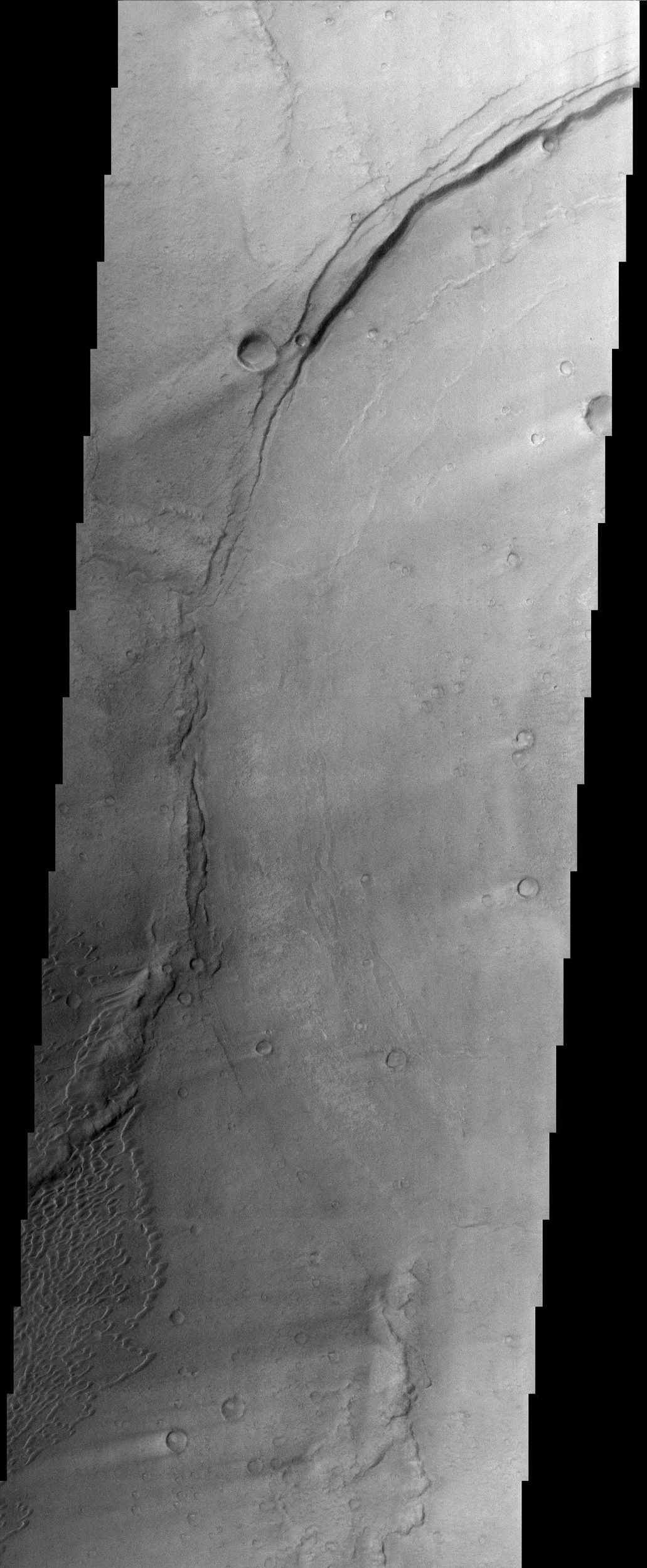 This image from NASA's Mars Odyssey is located in Meroe Patera, which is a small region within Syrtis Major Planitia. Syrtis Major is a low-relief shield volcano whose lava flows make up a plateau more than 1,000 km (about 620 miles) across.