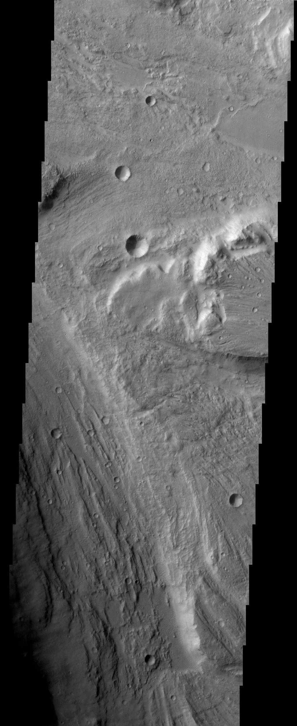The ancient, catastrophic floods on Mars, whose origins remain a mystery, produced a channeled and scoured landscape like this one, which is called Tiu Valles and was imaged by NASA's Mars Odyssey spacecraft.
