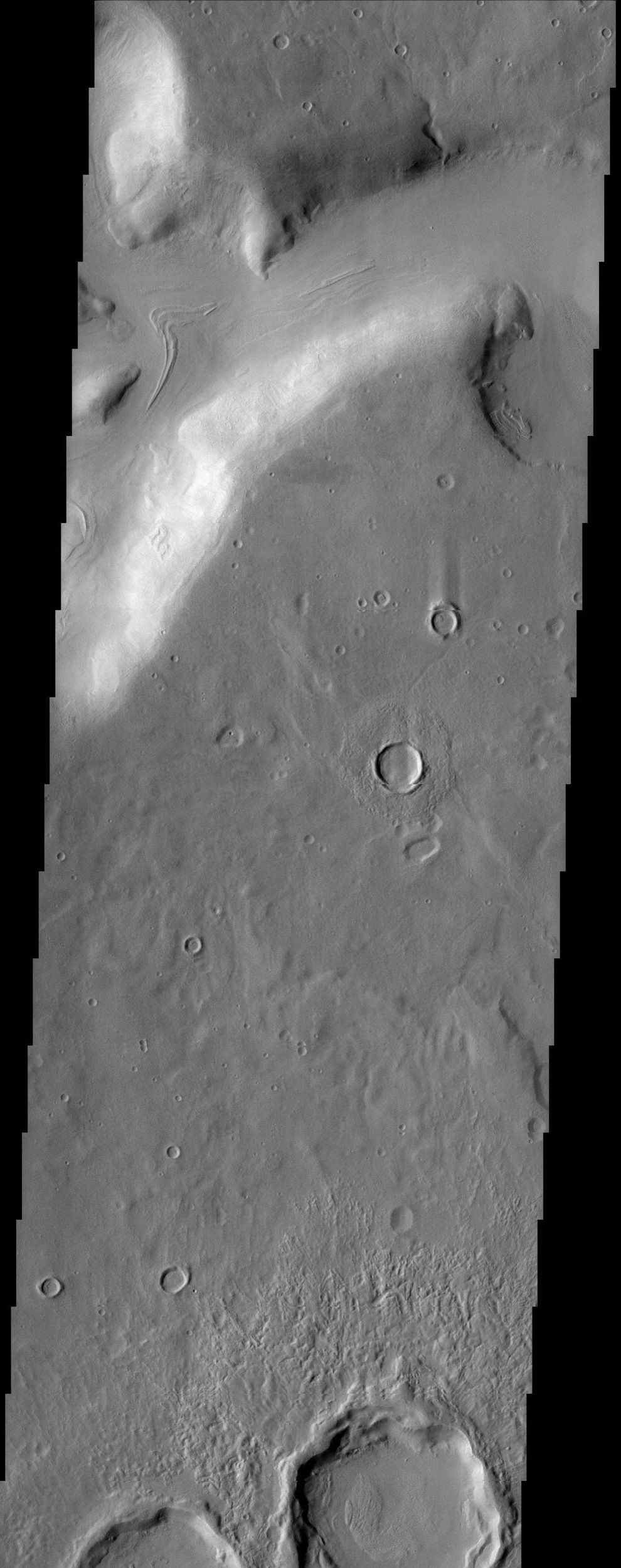 A fretted channel dominates this region of Ismeniae Fossae, imaged by NASA's Mars Odyssey. The topography of this region appears muted, most likely due to the presence of ground ice.