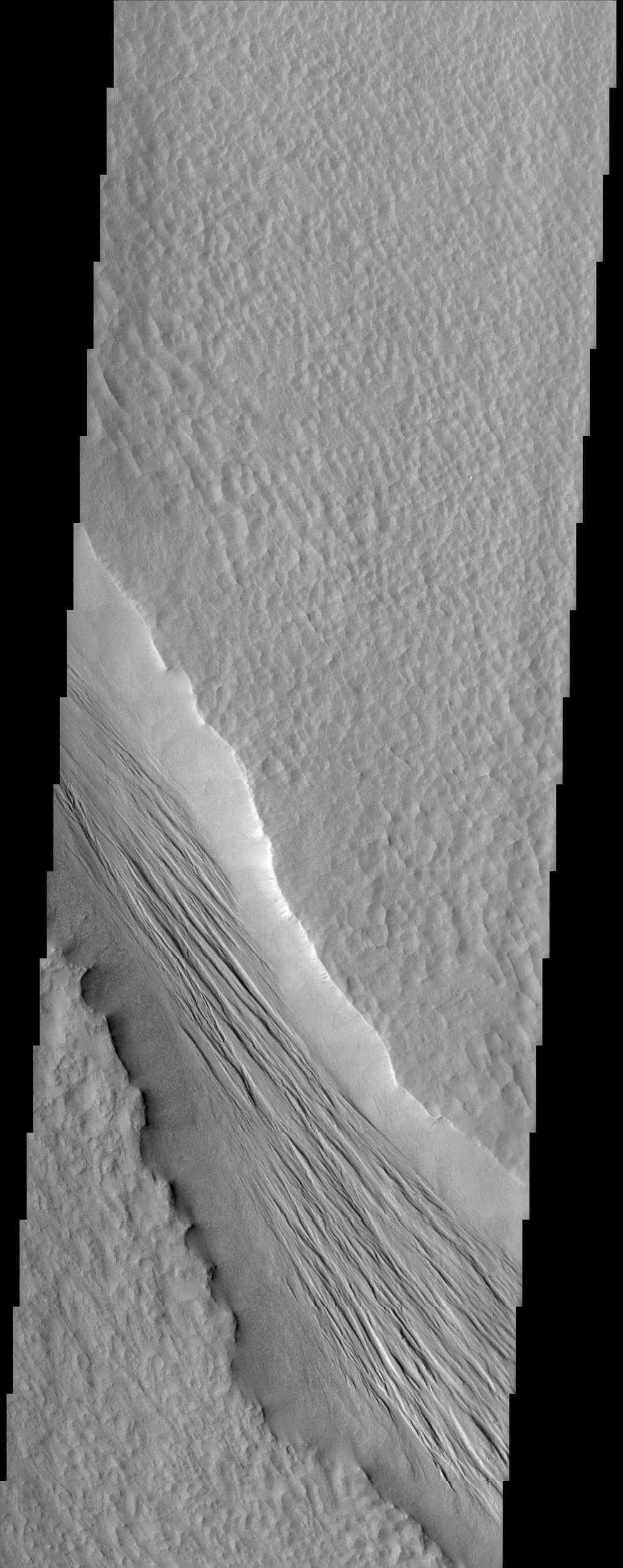 The Tharsis Montes region on Mars is a major center of volcanic and tectonic activity. The channel in this image from NASA's Mars Odyssey is west of the relatively small volcano called Biblis Patera although it shows no obvious relationship to it.