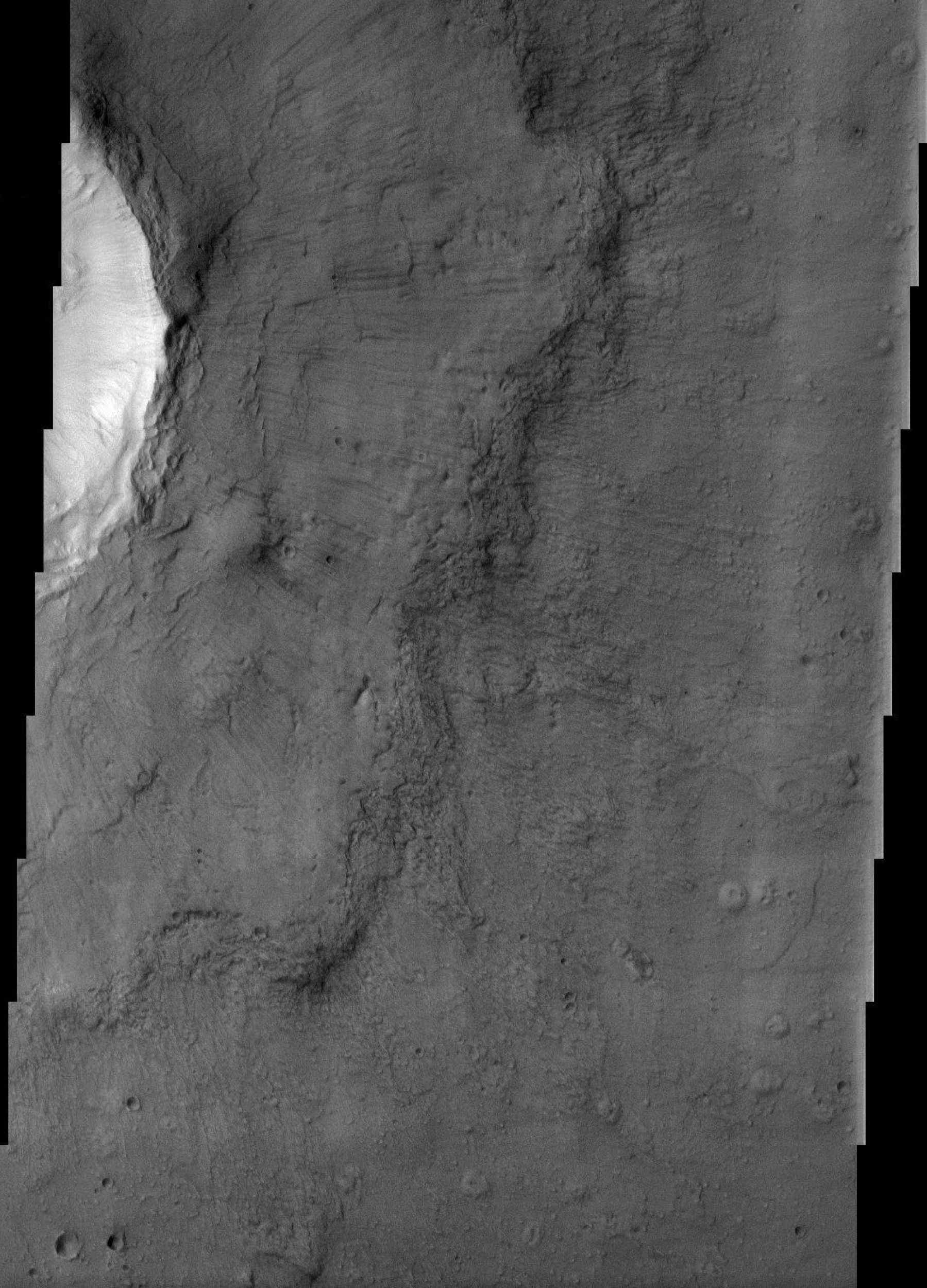 The ejecta blanket of the crater in this image from NASA's Mars Odyssey spacecraft does not resemble the blocky, discontinuous ejecta associated with most fresh craters on Mars.