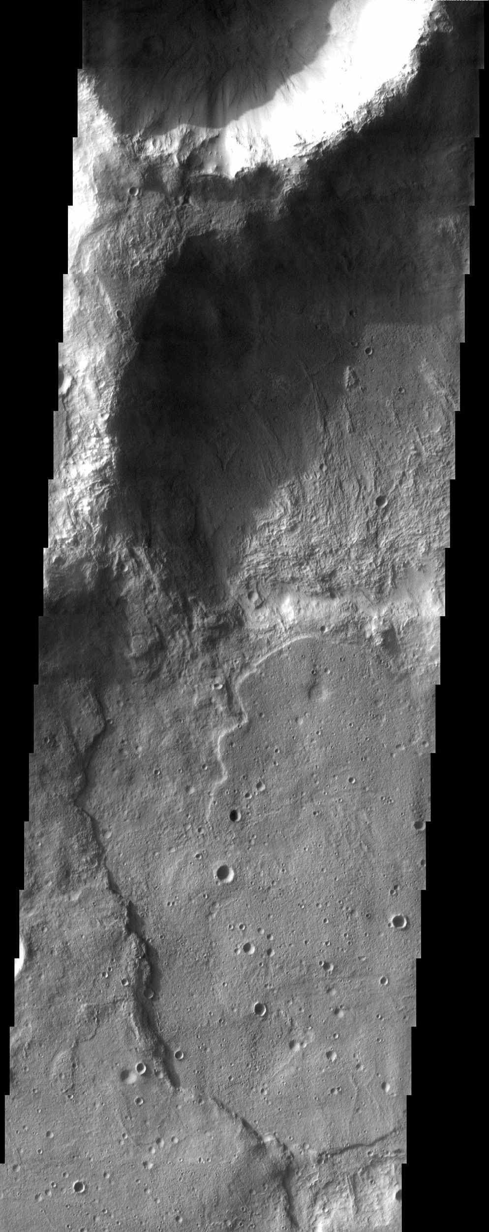 This pair of craters seen by NASA's Mars Odyssey just north of the Hellas Basin demonstrate the rugged topography that can result when an impact occurs on the rim of an existing crater.