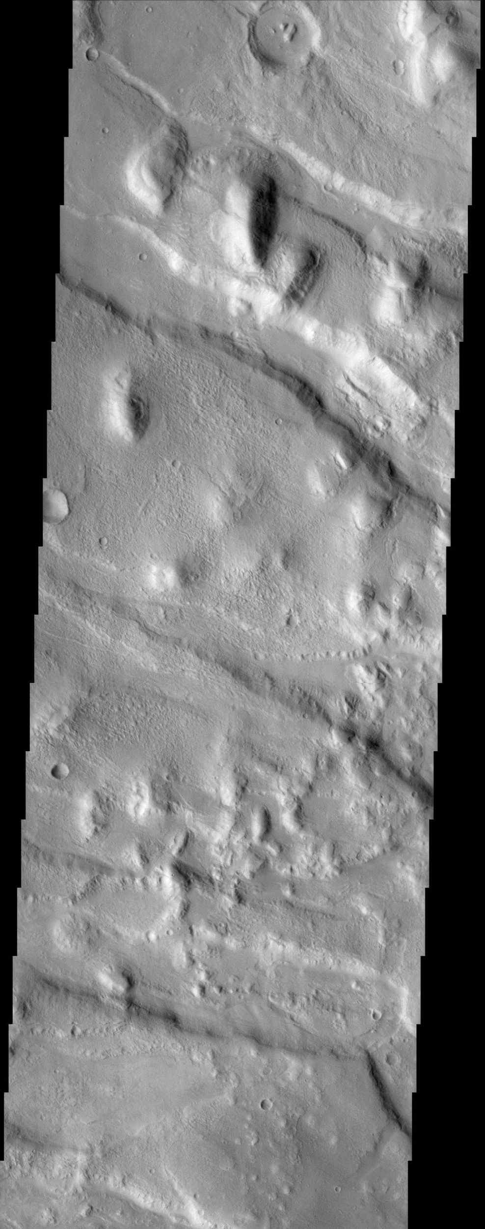 Located north of Olympus Mons and west of Alba Patera, Acheron Fossae, seen in this NASA Mars Odyssey image, provides a record of early tectonic activity in the Tharsis region.