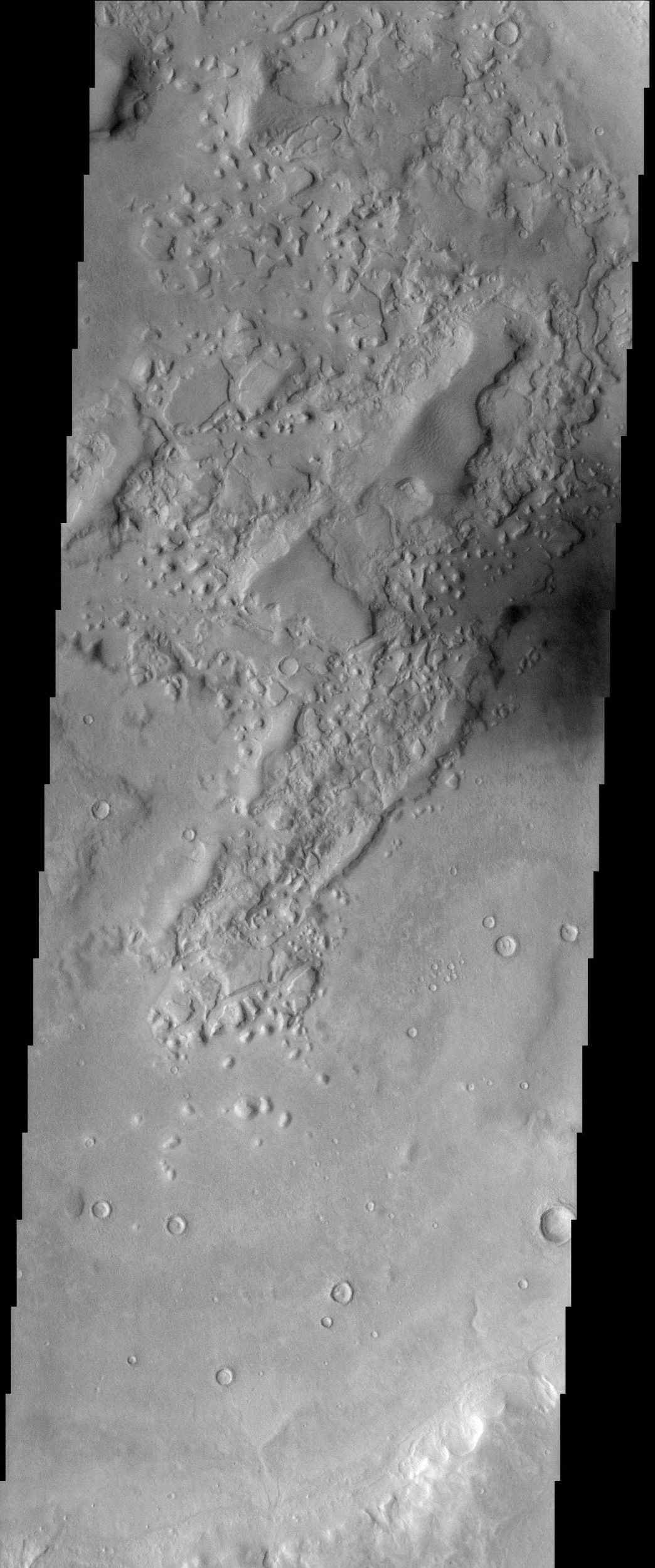 This image from NASA's Mars Odyssey spacecraft shows a location within Semeykin Crater, which is in the Martian northern hemisphere.