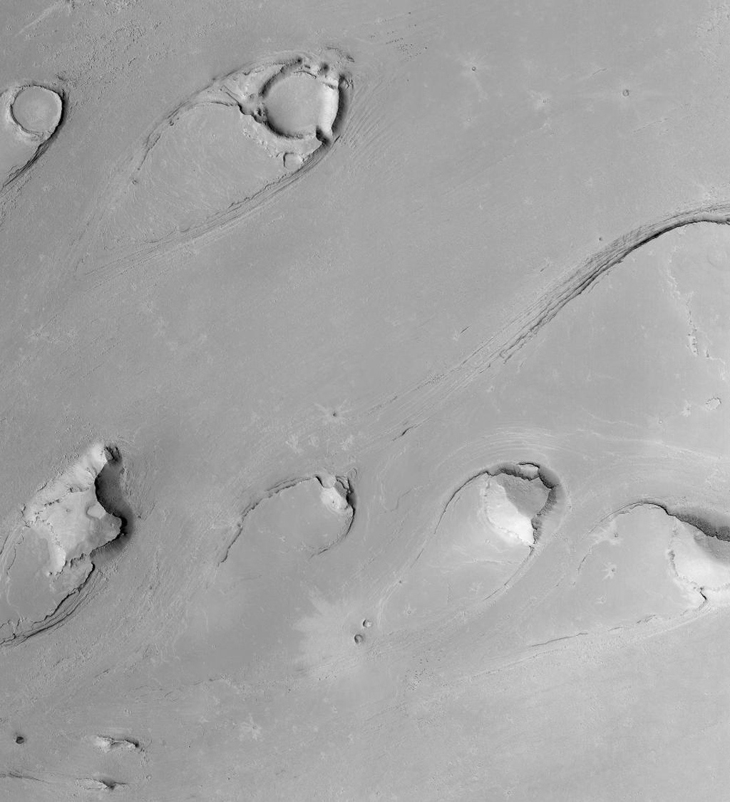 NASA's Mars Global Surveyor shows tear drop-shaped landforms in Athabasca Vallis in the Cerberus region of Mars, south of the Elysium volcanoes.