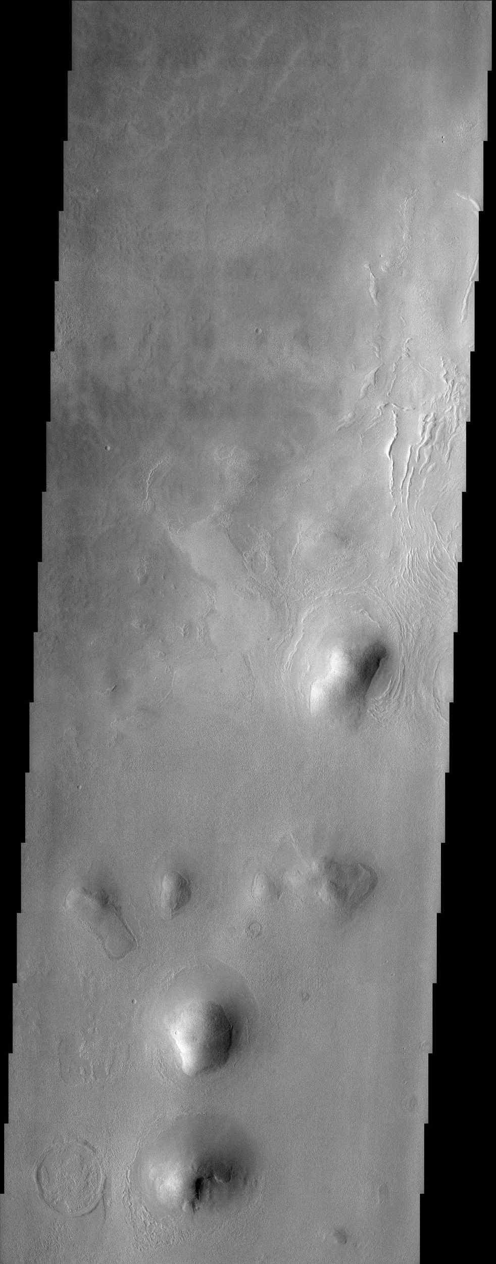 This NASA Mars Odyssey image of rounded hills and ridges in Arcadia Planitia shows a very intriguing geomorphic feature that may be attributed to the presence of an icy-rock mixture of material.