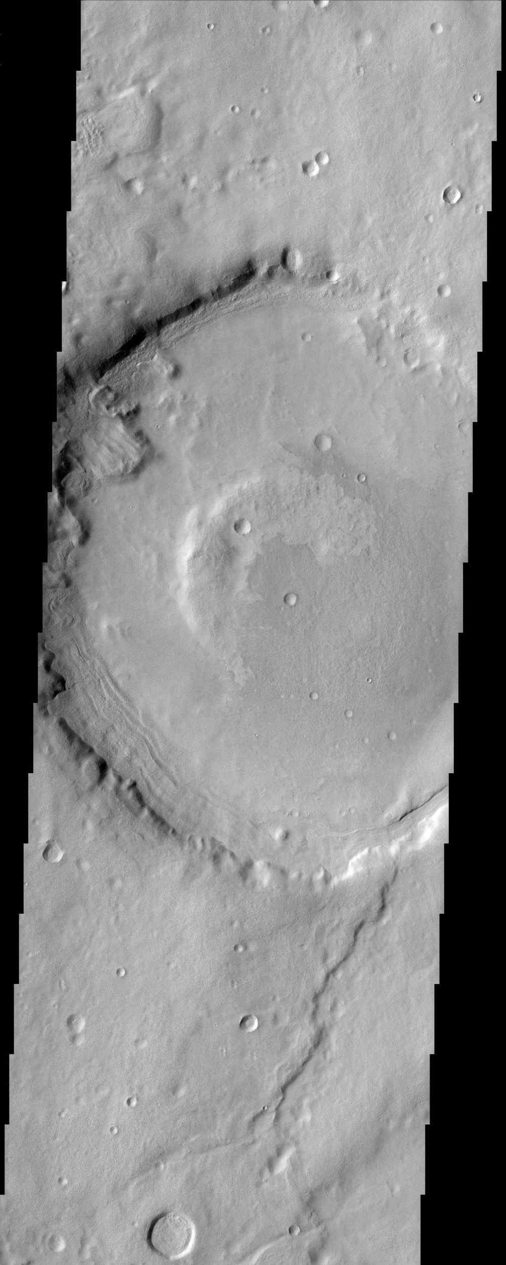 The impact crater in this NASA Mars Odyssey image is a model illustration of the effects of erosion on Mars. The degraded crater rim and several landslides observed in crater walls are evidence of the mass wasting of materials.
