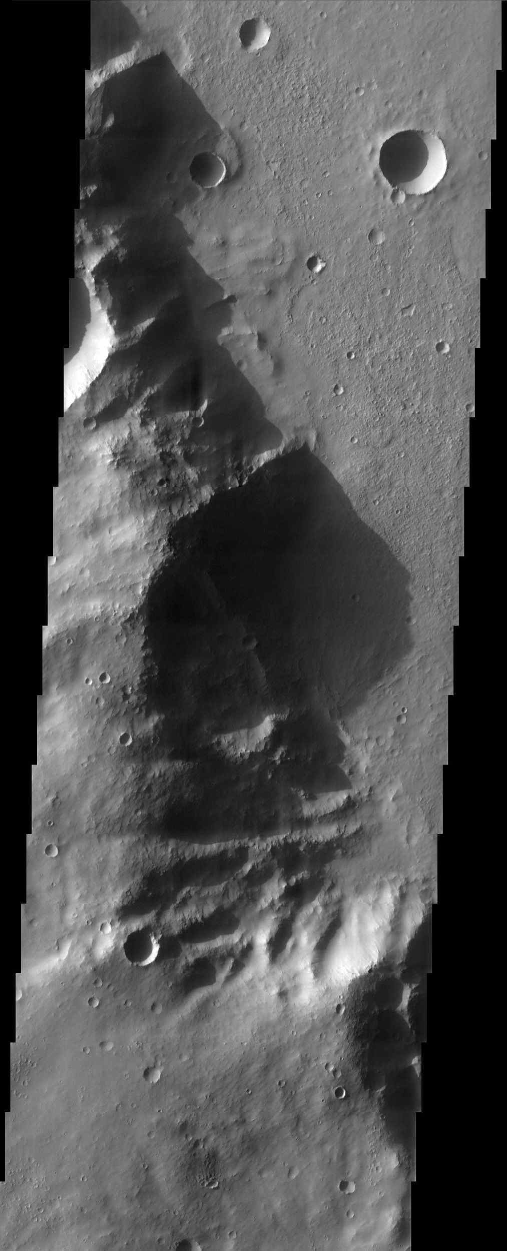 In this image from NASA's Mars Odyssey, the late afternoon sun casts a shadow over a rim of Huygens Crater that's 700 meters (nearly 2,300 feet) high.