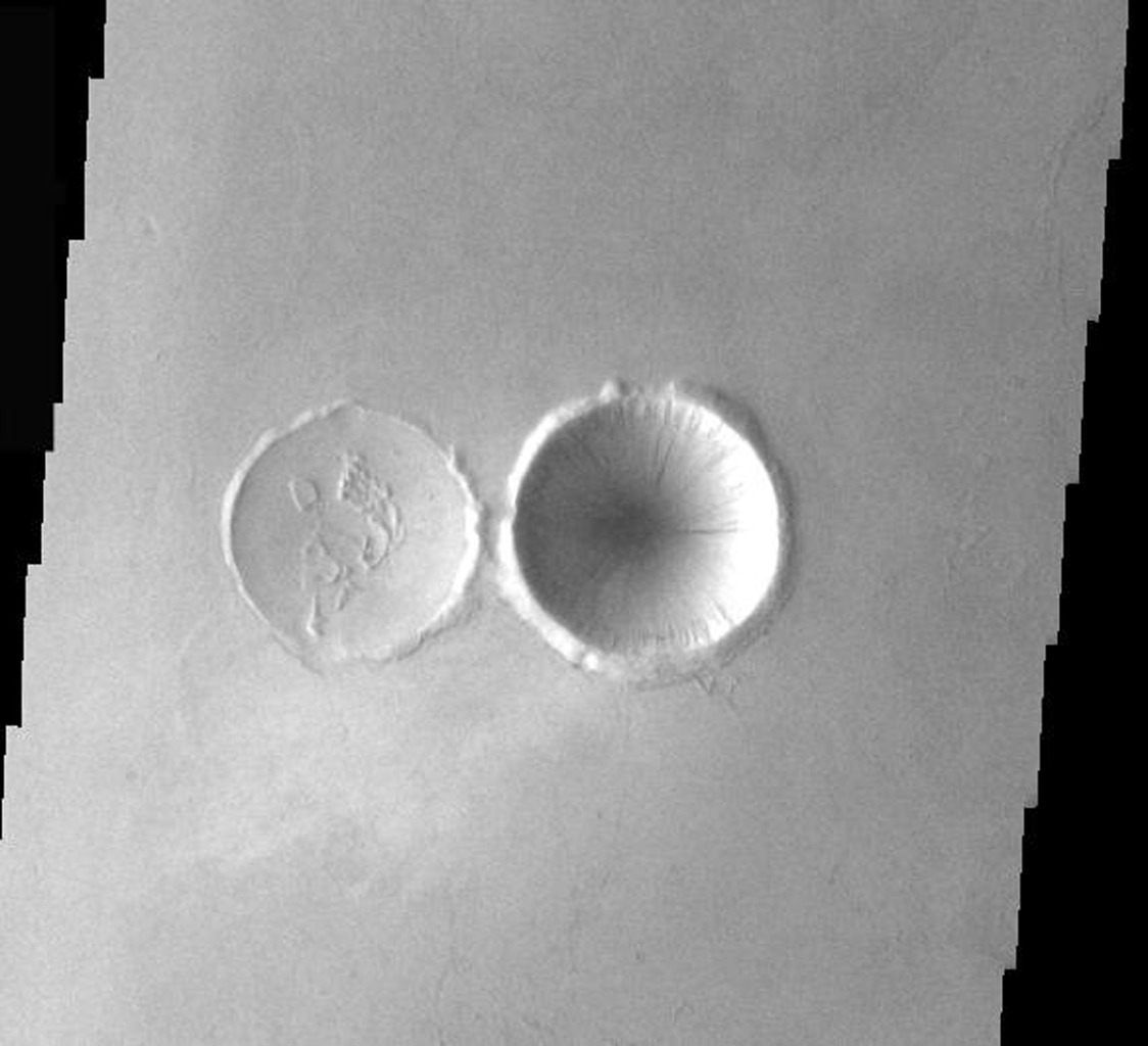 This image from NASA's Mars Odyssey shows two types of crater interiors found on Mars, original and modified. The crater on the right has its original bowl shape. The crater of the left has had its interior modified by an infilling of lava.