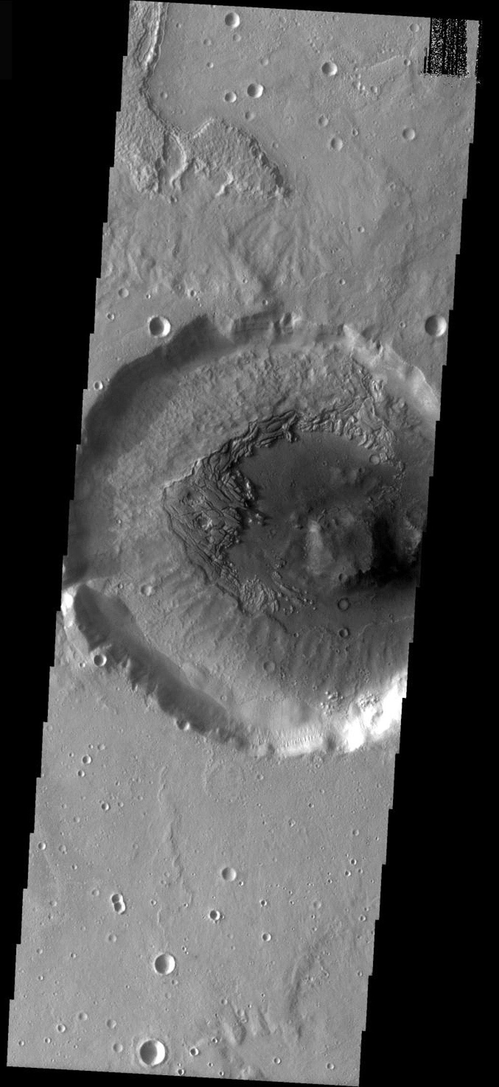 This image from NASA's Mars Odyssey shows a crater interior on Mars filled by a thick accumulation of material. The fill is now undergoing removal, exposing the floor beneath the material.
