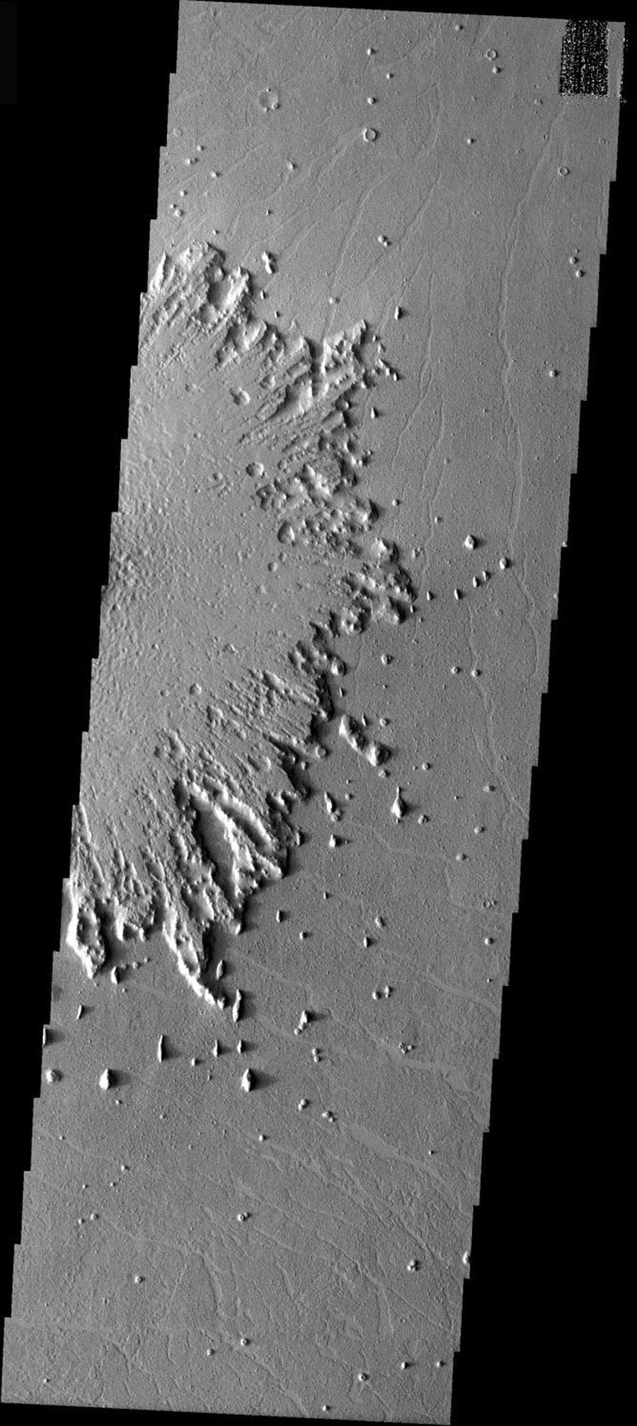 This image from NASA's Mars Odyssey shows ejecta surrounding a crater on Mars has undergone significant erosion by the wind. The wind has stripped the surface features from the ejecta and has started to winnow away the ejecta blanket.