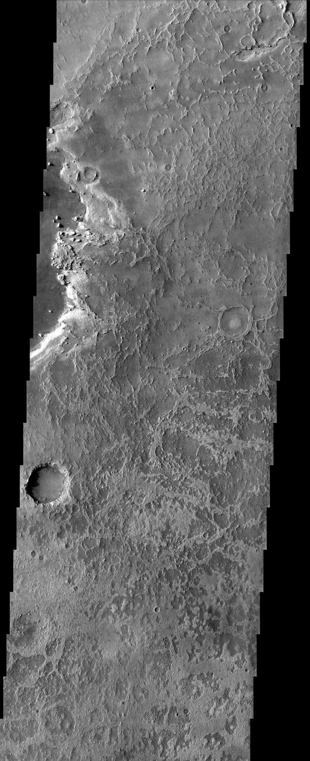 Eroded, or 'etched' terrain dominates the field of view of this image from NASA's Mars Odyssey spacecraft, acquired over eastern Terra Meridiani. At the bottom of many craters and in other areas, dunes are present.