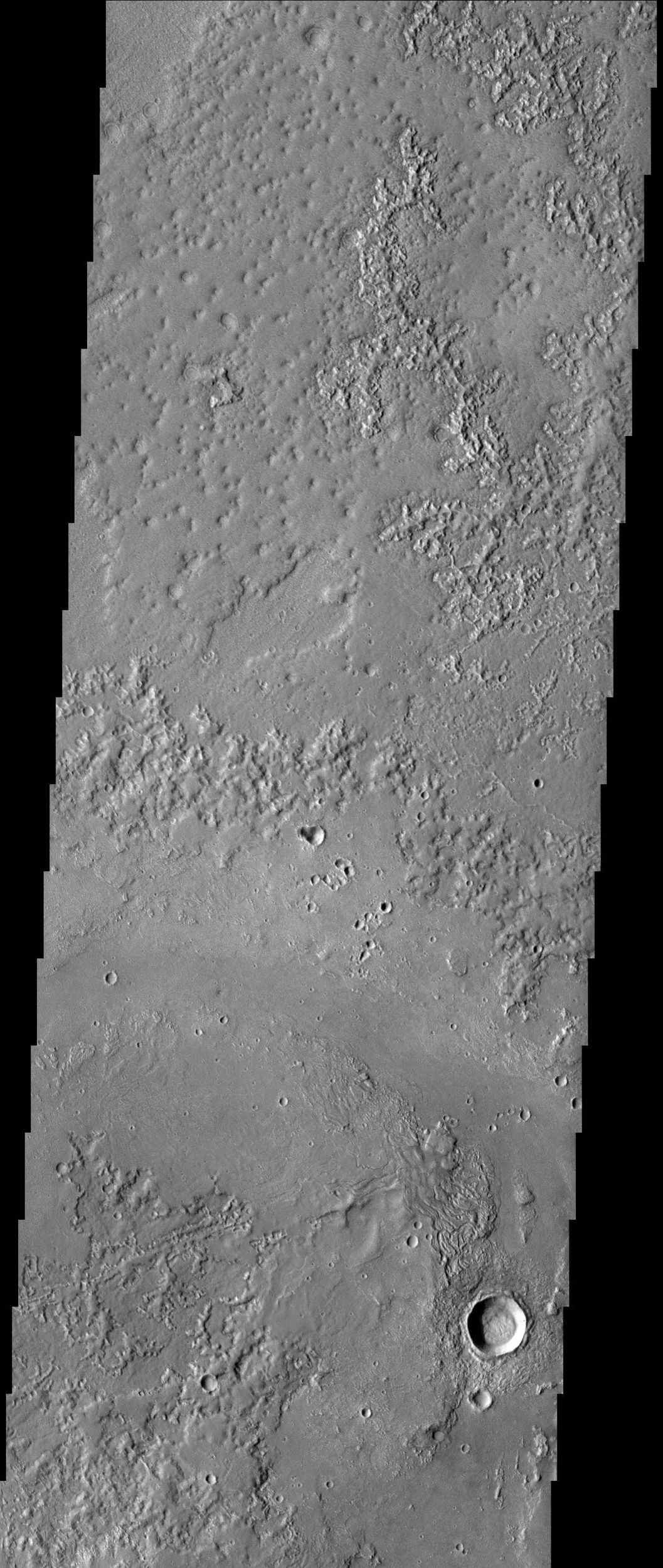 This image from NASA's Mars Odyssey spacecraft shows Granicus Vallis, which is located northwest of the Elysium volcanic complex and may owe its origin to the interaction of volcanic heating and subsurface ground ice.