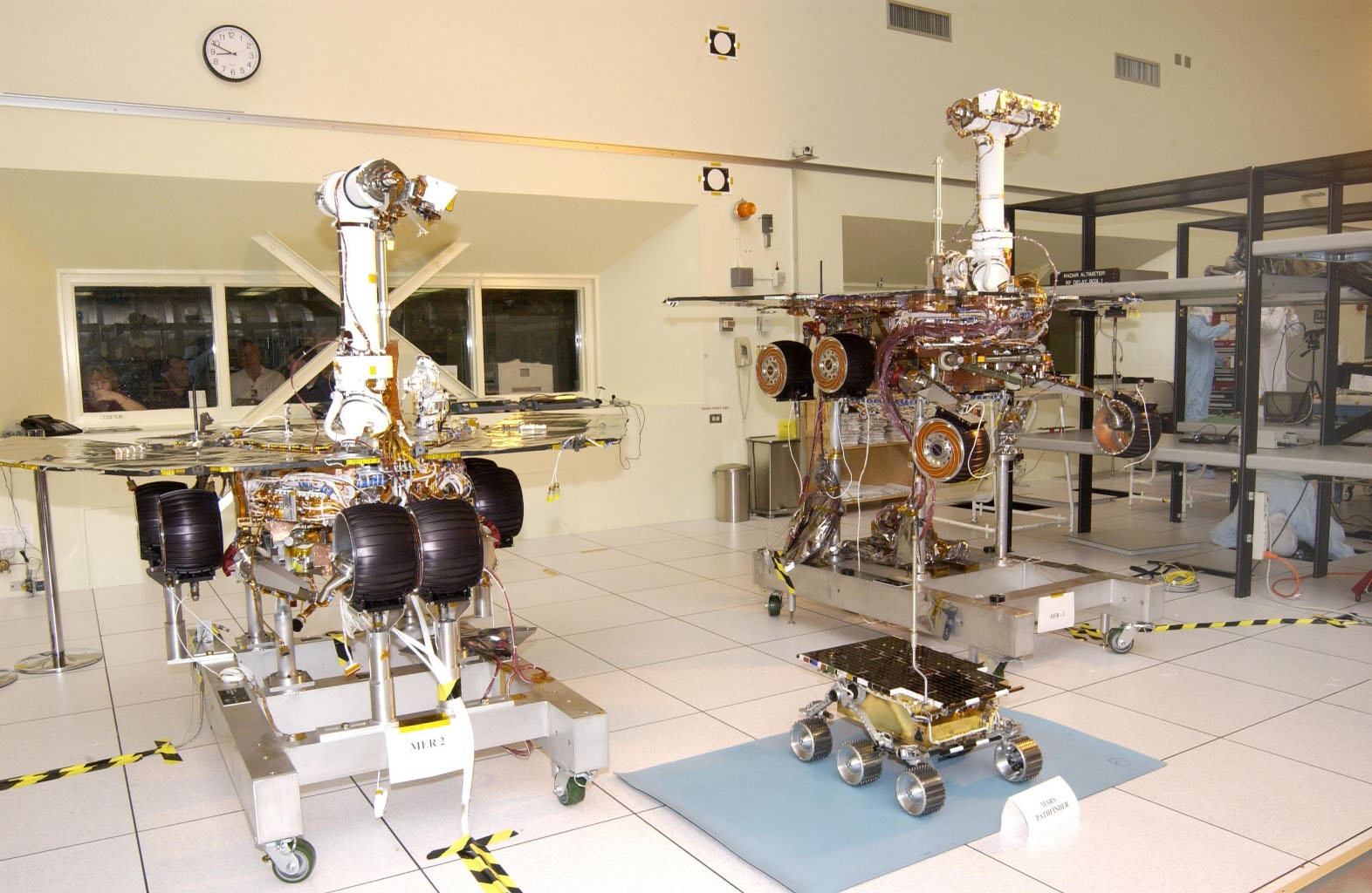 The twin rovers of NASA'a Mars Exploration Rover Mission pose with their groundbreaking predecessor, the flight spare of the Sojourner rover from NASA's 1997 Pathfinder mission.