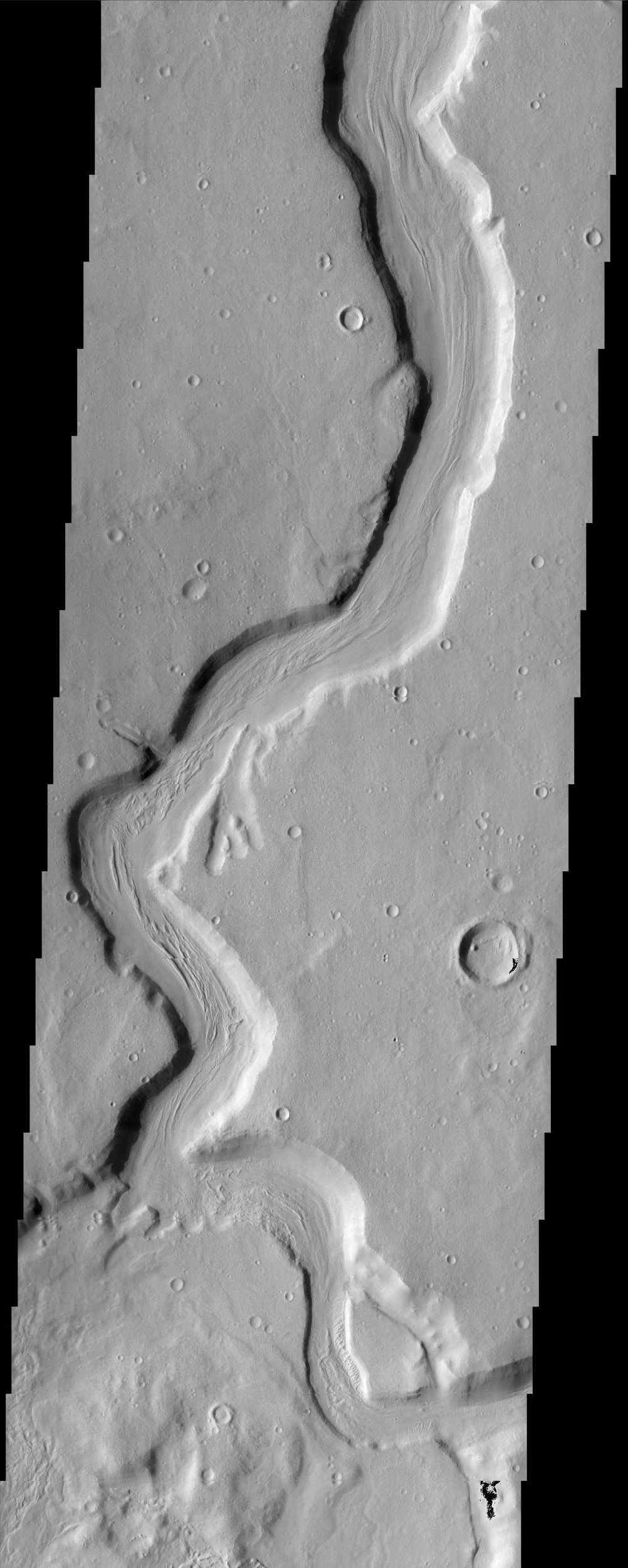 The sinuous channel in this NASA Mars Odyssey image begins at the edge of Cerulli Crater in northern Arabia and snakes its way across 1,000 km (621 miles) of cratered highlands before reaching Deuteronilus Mensae at the boundary of the northern lowlands.